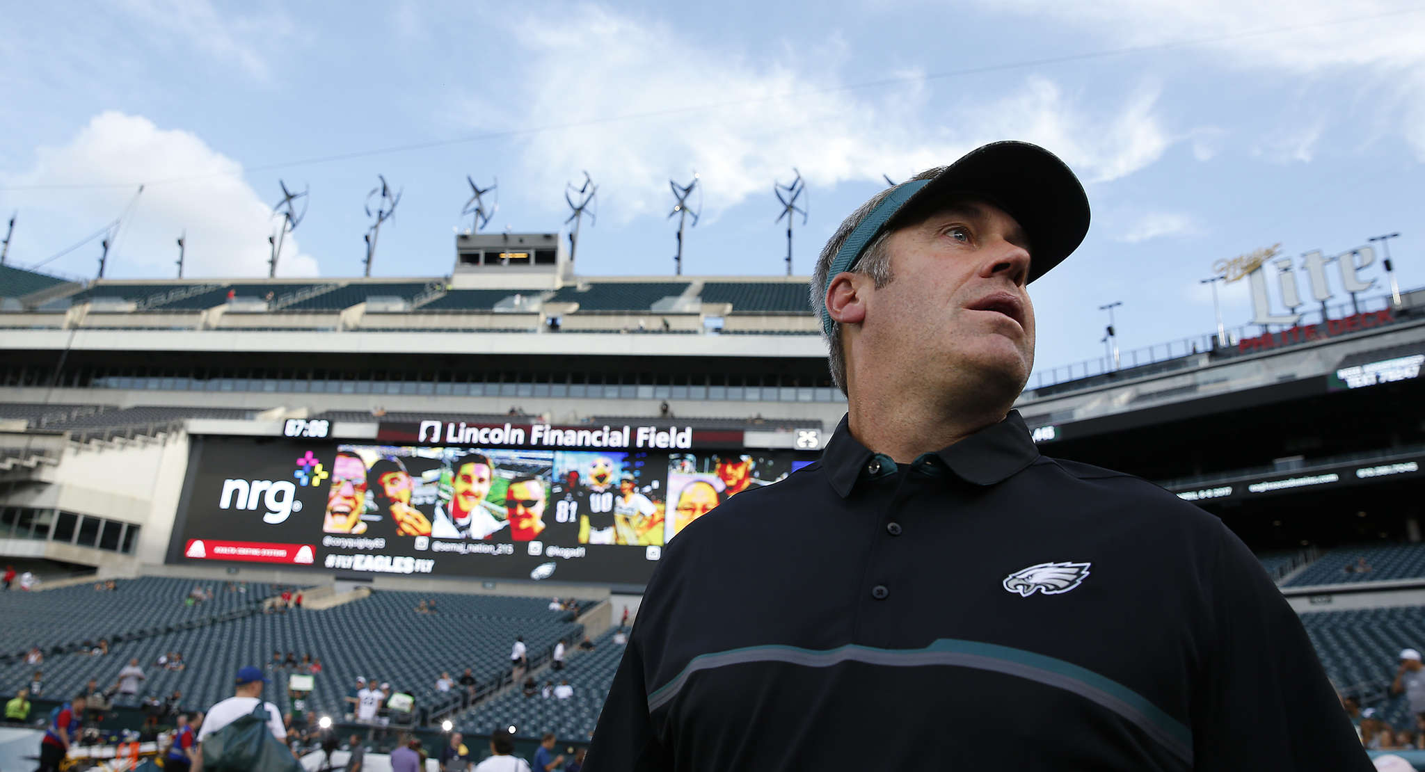 Eagles Doug Pederson takes the field during warmups before the preseason opener at Lincoln Financial Field against the Tampa Bay Buccaneers.