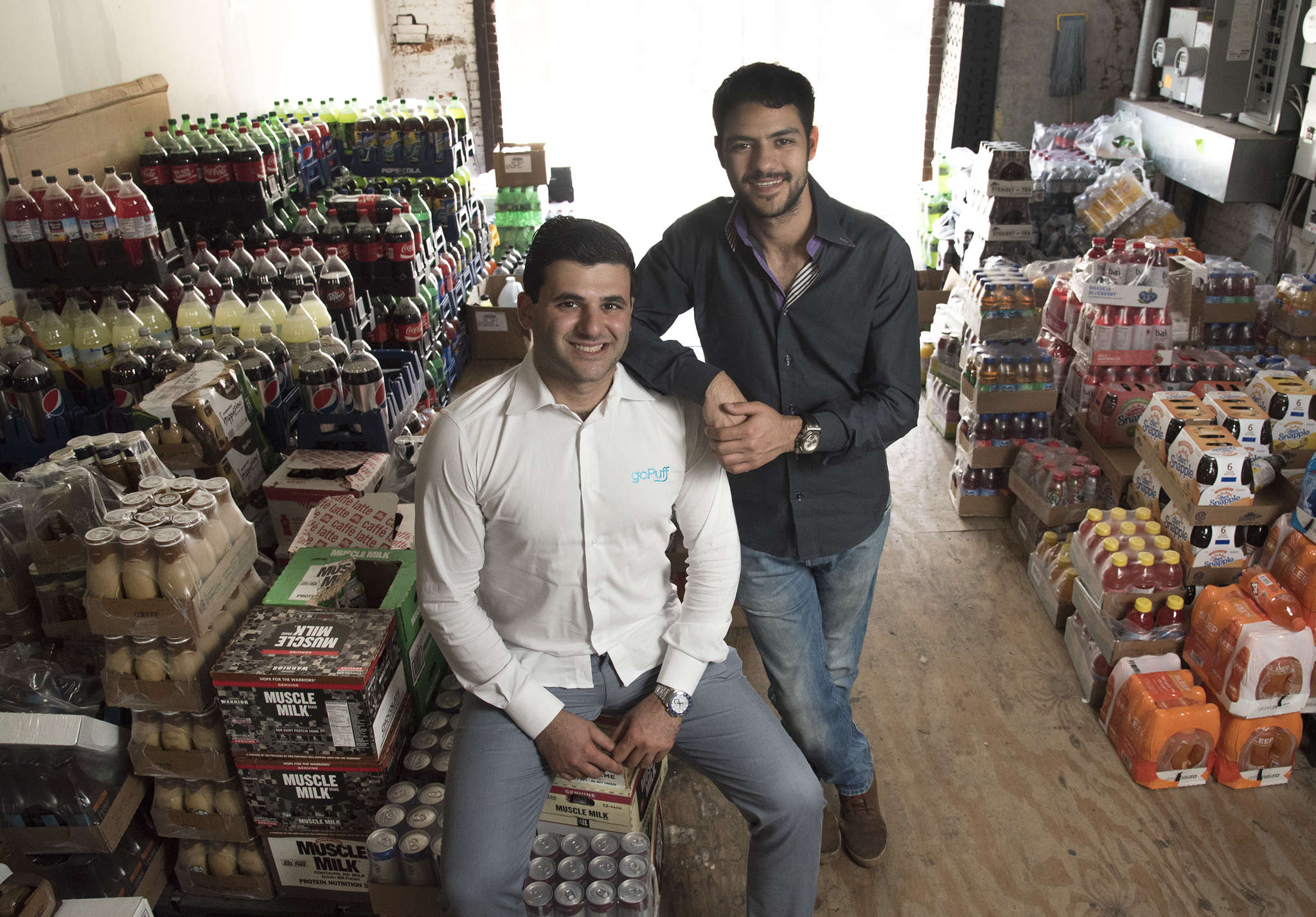 """GoPuff cofounders Rafael Ilishayev (left) and Yakir Gola, in one of their four warehouses. The former Drexel roommates´ """"Wawa on wheels"""" now serves Manayunk, Roxborough, and the Main Line."""