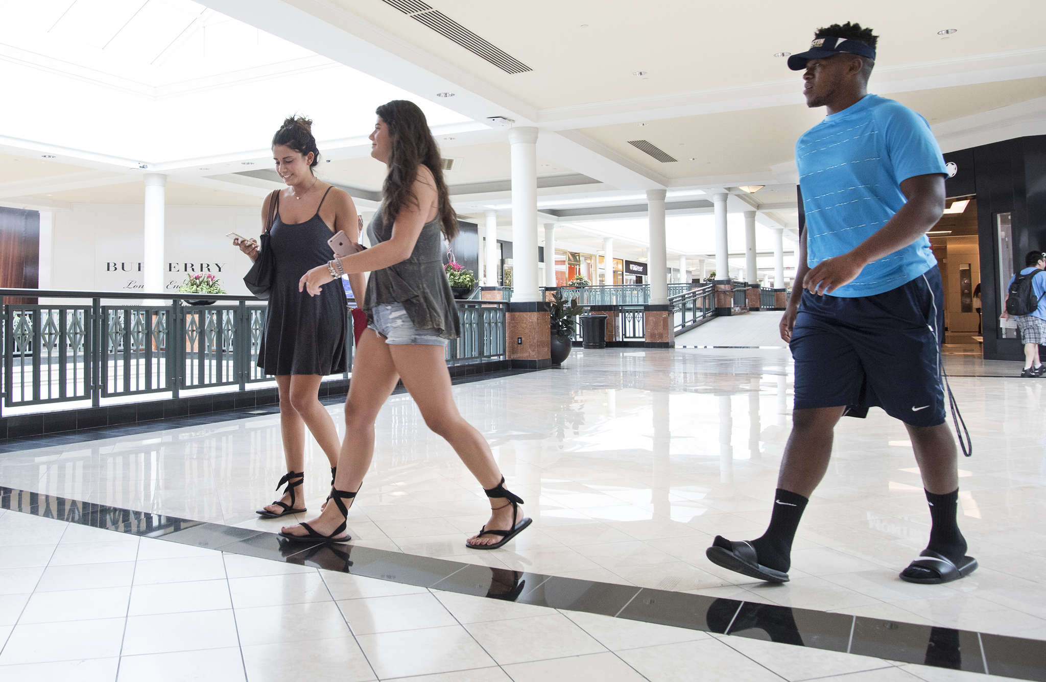 King of Prussia patrons (from left) Jen Demyan, Alessia Mattera, and Richard Mattis said they were eager to see what the luxury retailers were offering.