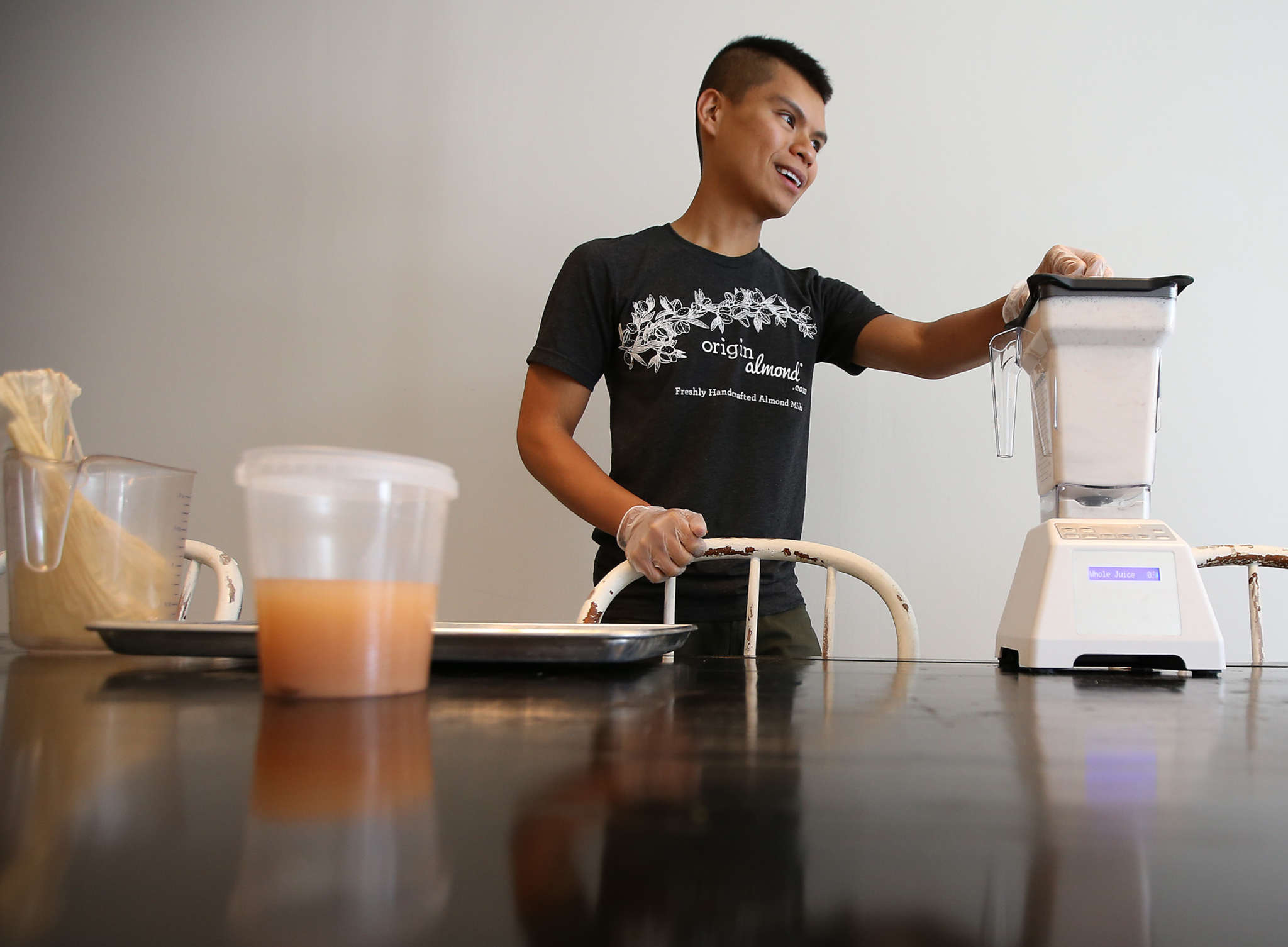 Jacob Deleon , the entrepreneur behind Origin Almond, makes an almond milk drink at Heart Beet Kitchen in Westmont. He also has Whole Foods as an outlet, among others. DAVID MAIALETTI / Staff Photographer