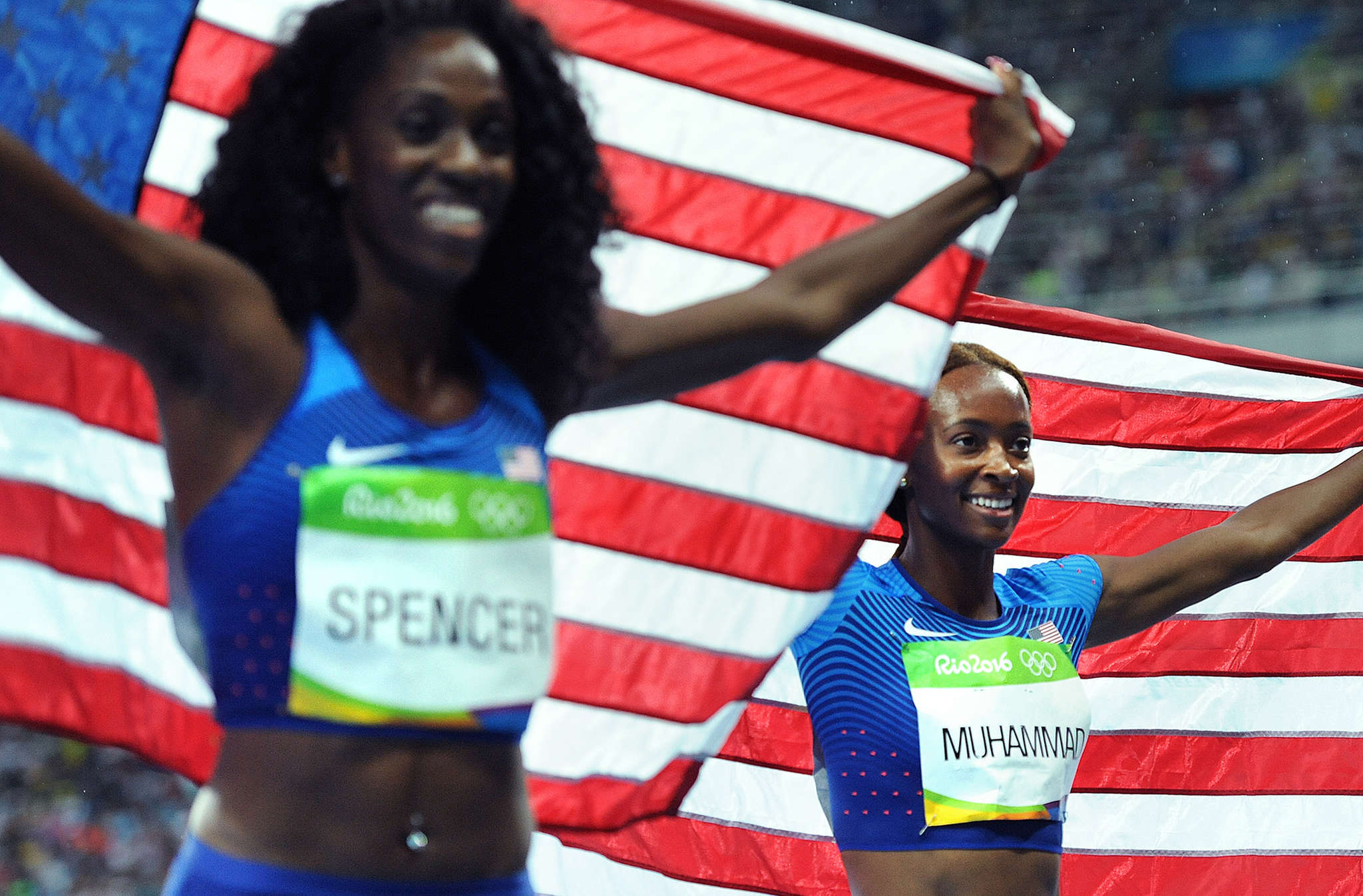 Hurdlers Ashley Spencer (left) and Dalilah Muhammed are part of the diverse U.S. Olympic team.