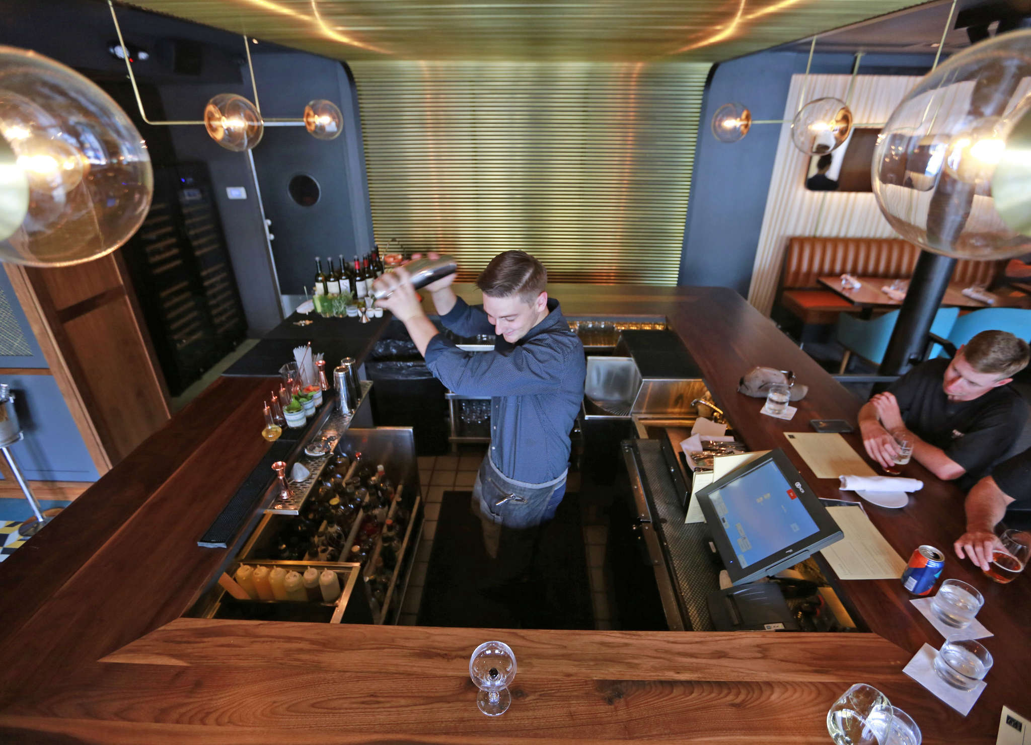 Aaron Deary behind the bar at Root in Fishtown. Root´s wines by the glass avoid conventional choicesin favor of bracing Chignin, aromatic Italian ansonica, earthy gamay, ripe Portuguese baga, and Greek xinomavro.
