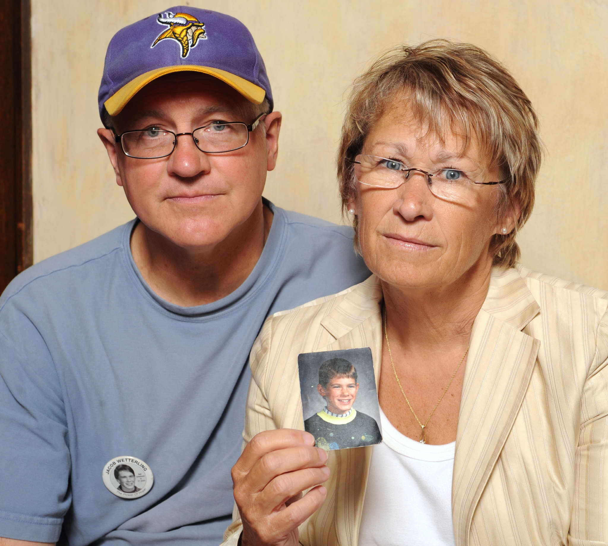 Jerry and Patty Wetterling show a photo of their son Jacob, who was abducted in 1989 in St. Joseph, Minn. His remains were found this week, and a man confessed to Jacob´s murder.