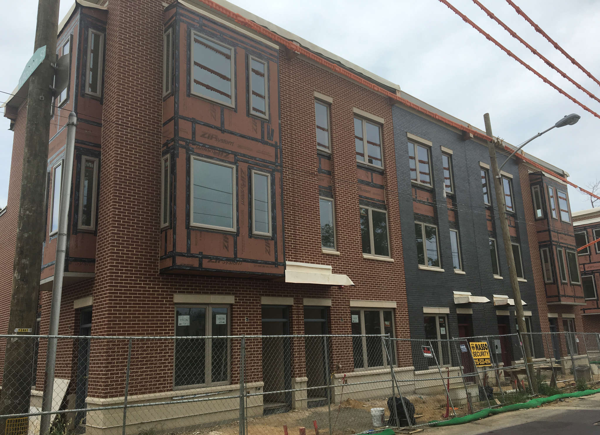 New rowhouses on the site of the former Blumberg Towers are faced in good-quality brick.