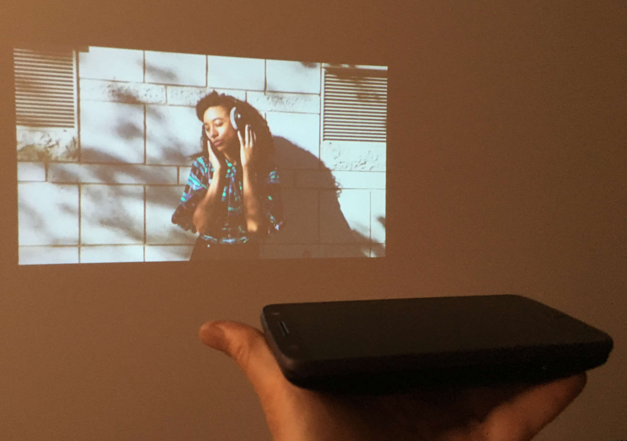 A Motorola Z Force Droid smartphone demonstrates the Insta-Share Projector mod.
