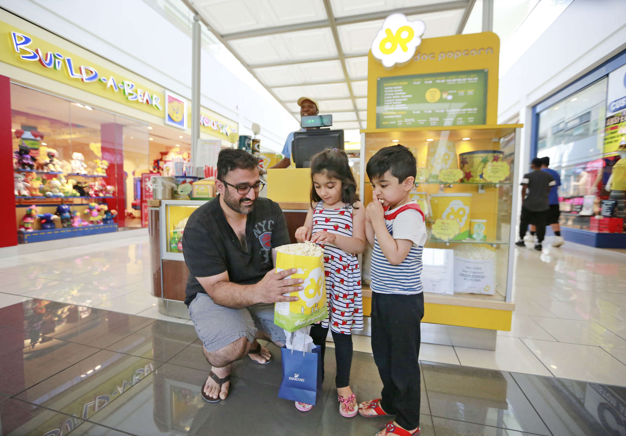 Laeeq Arshad with popcorn for his daughter Ayat and son Azan, at Cherry Hill Mall. Philadelphia is a walkable city, and popcorn is a good snack fit.