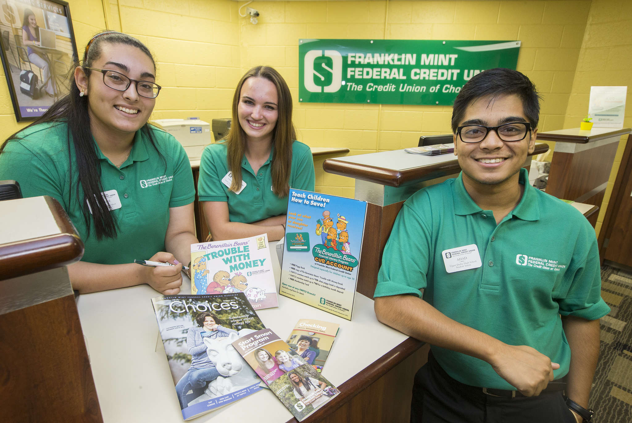 Students (from left) Mariam Sharobeem, Valerie Cheney, and Ahad Rafi worked at Franklin Mint Federal Credit Union branches set up in their high schools and said they learned a lot about personal finance.