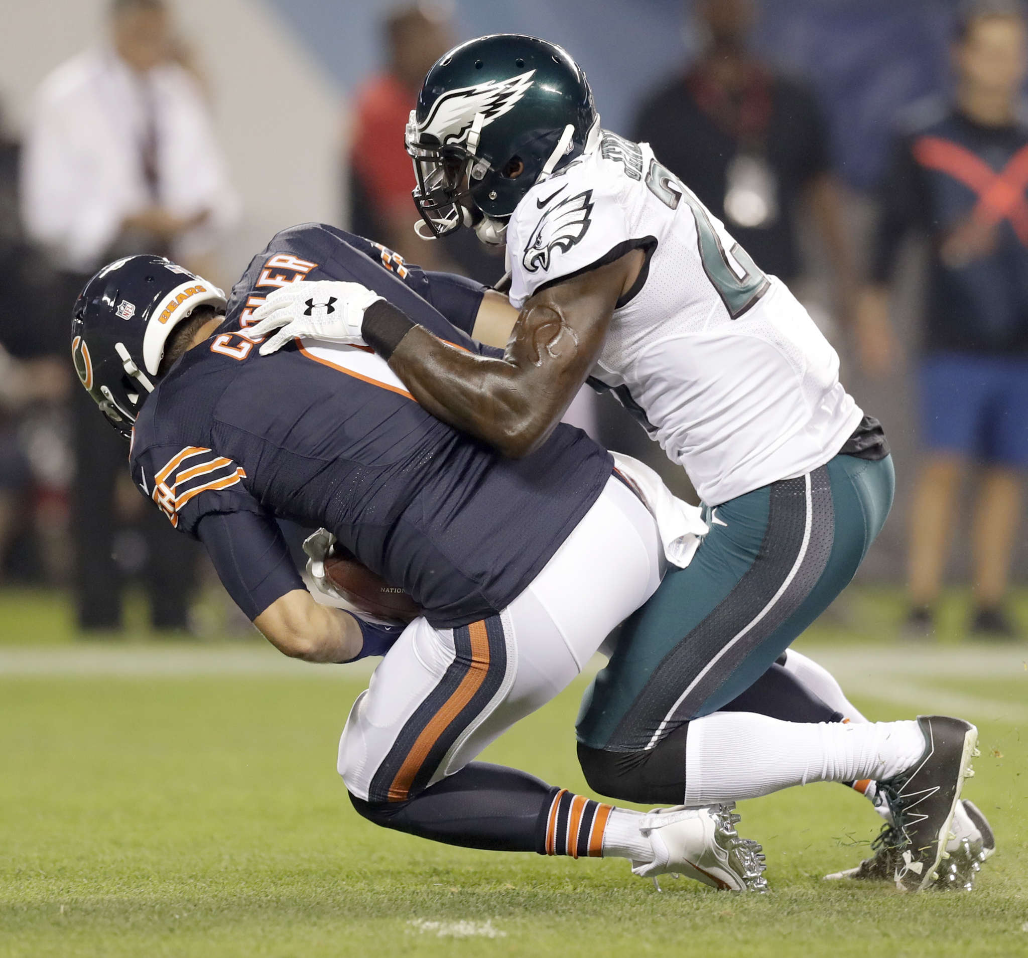 Malcolm Jenkins , who was one of threeEagles to raise their fists in protest during the national anthem Monday night, sacks Bears´ Jay Cutler during the first quarter. YONG KIM / Staff Photographer