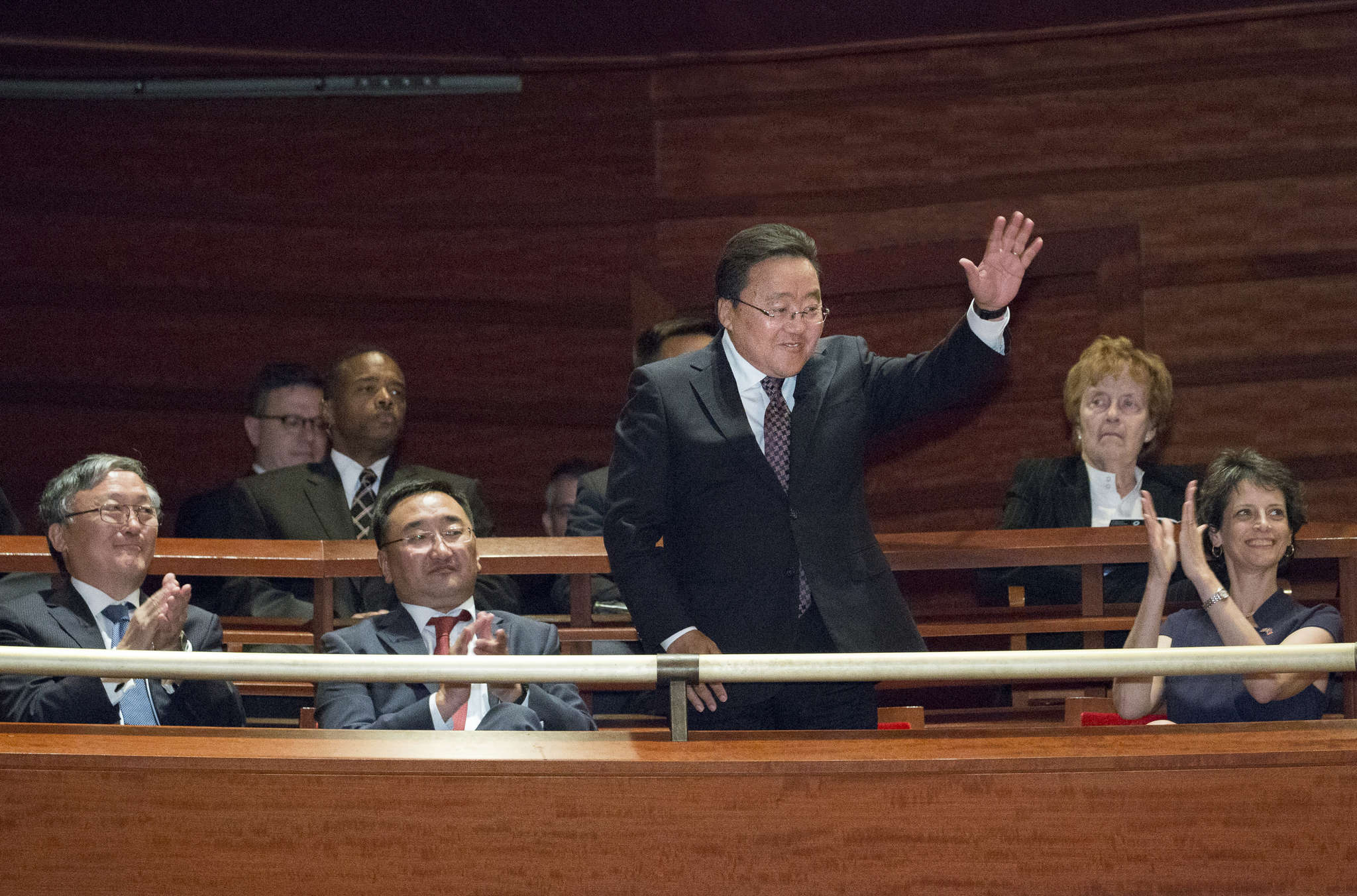Mongolian President Tsakhiagiin Elbegdorj acknowledges applause at the start of a special concert at the Kimmel Center. The orchestra will visit his country next June as part of an Asian tour.