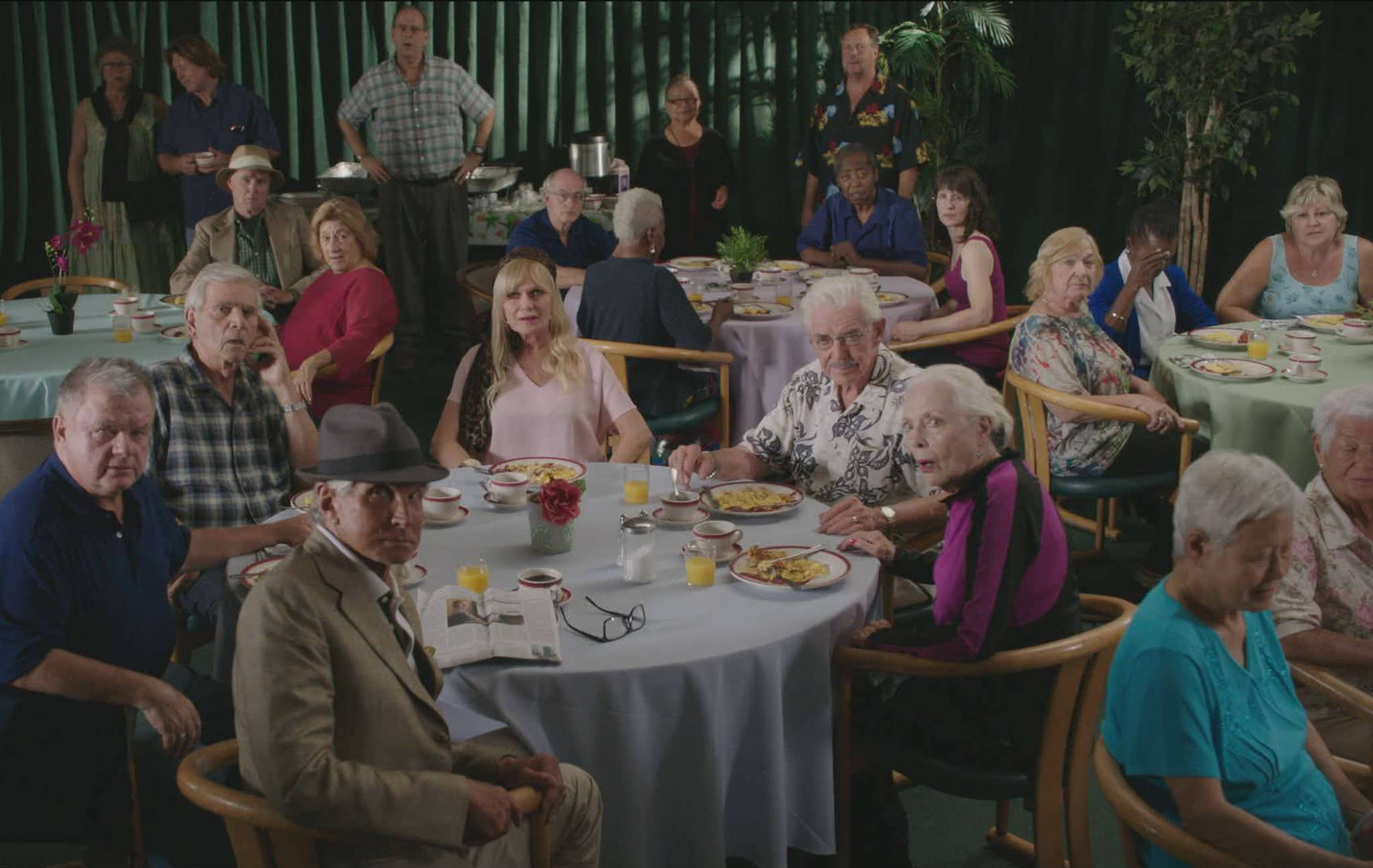 """The cast of """"Silver Skies."""" The film centers on a group of seniors and retirees whose apartment building is sold out from under them."""