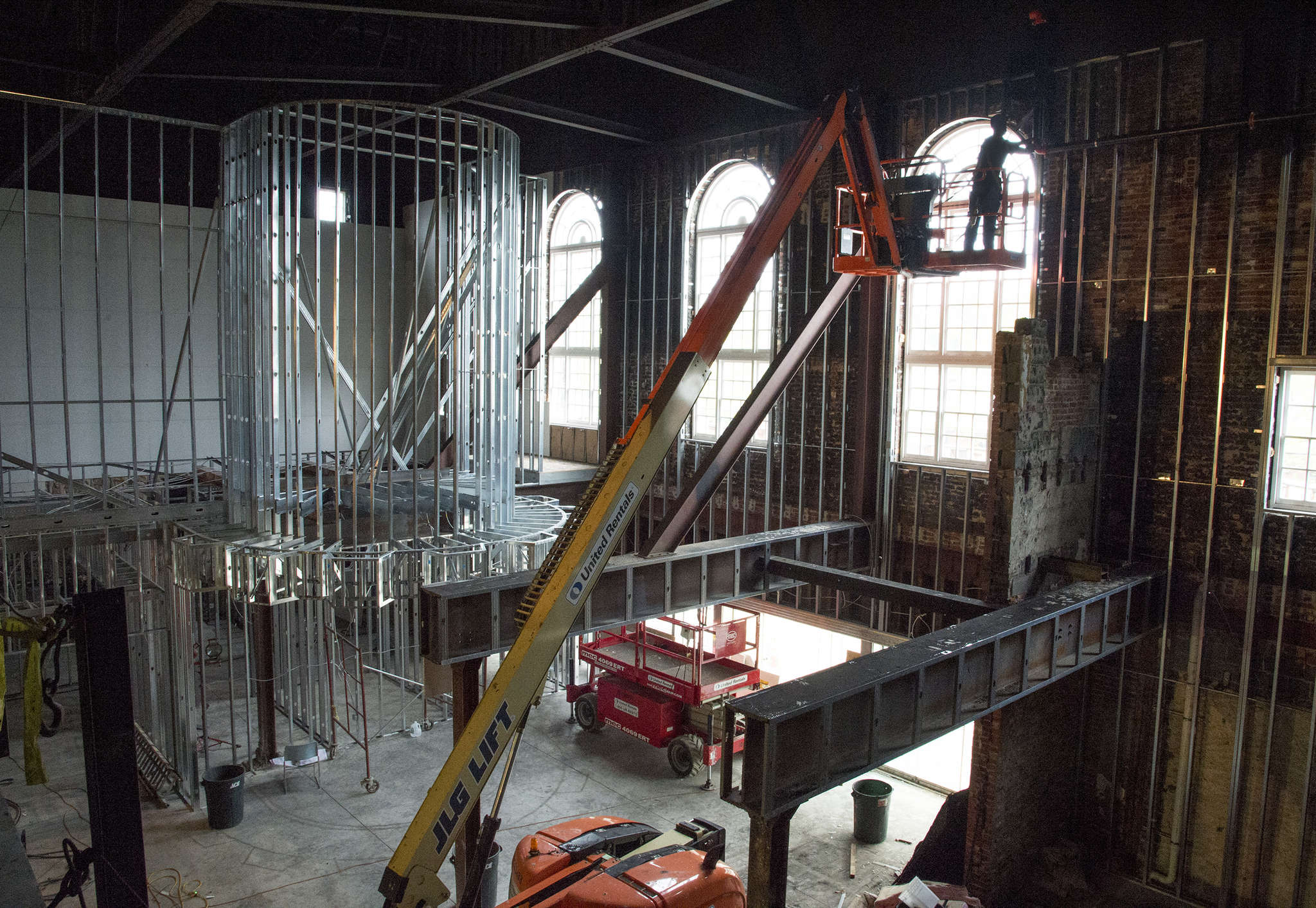 Work goes on at the Westmont Theater. Built in 1927, it will become a Planet Fitness center.