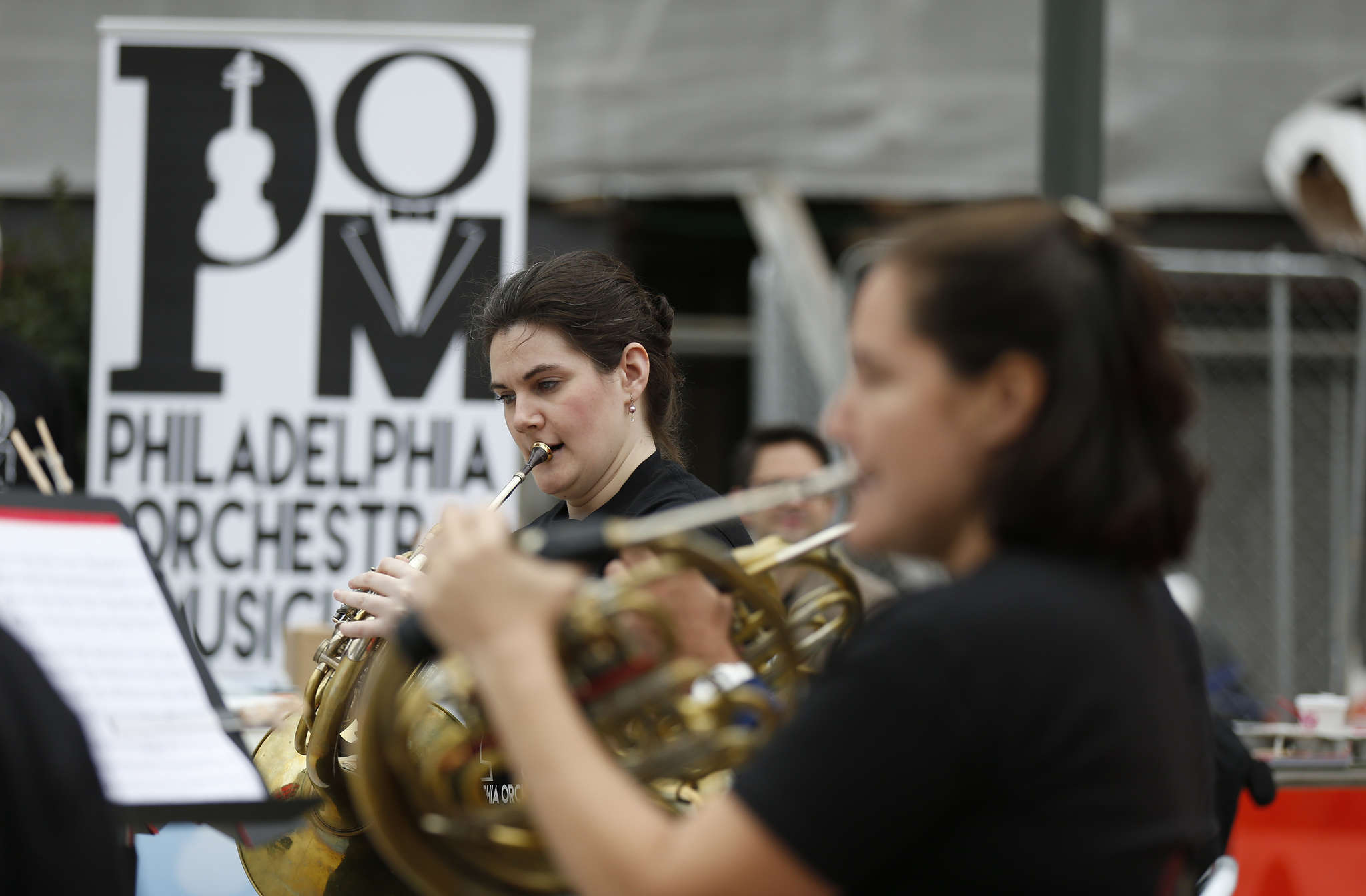 Bryn Coveney, a student at the Curtis Institute of Music, plays with members of the Philadelphia Orchestra outside 30th Street Station, one of several concerts by orchestra musicians throughout the Philadelphia area.