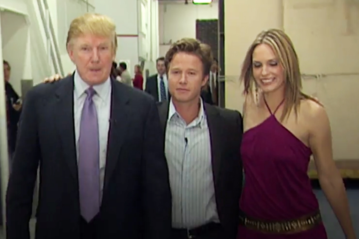 """Donald Trump shown with then """"Access Hollywood"""" co-host Billy Bush (center) and actress Arianne Zucker on the set of """"Days of Our Lives"""" in 2005. Trump was caught in a crude conversation with Bush about Zucker and other women on the bus ride to the set."""