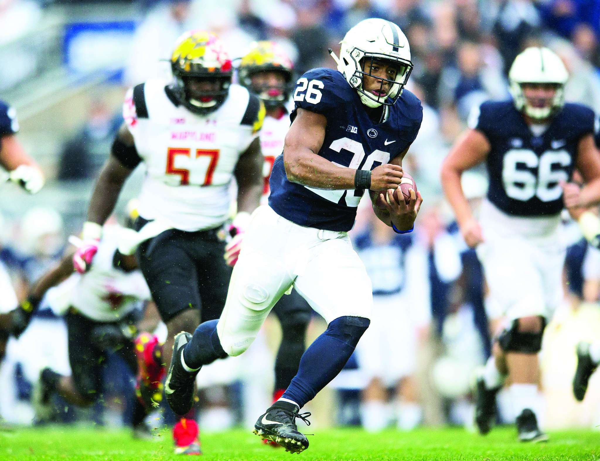 Penn State´s Saquon Barkley looks for running room against Maryland. TNS
