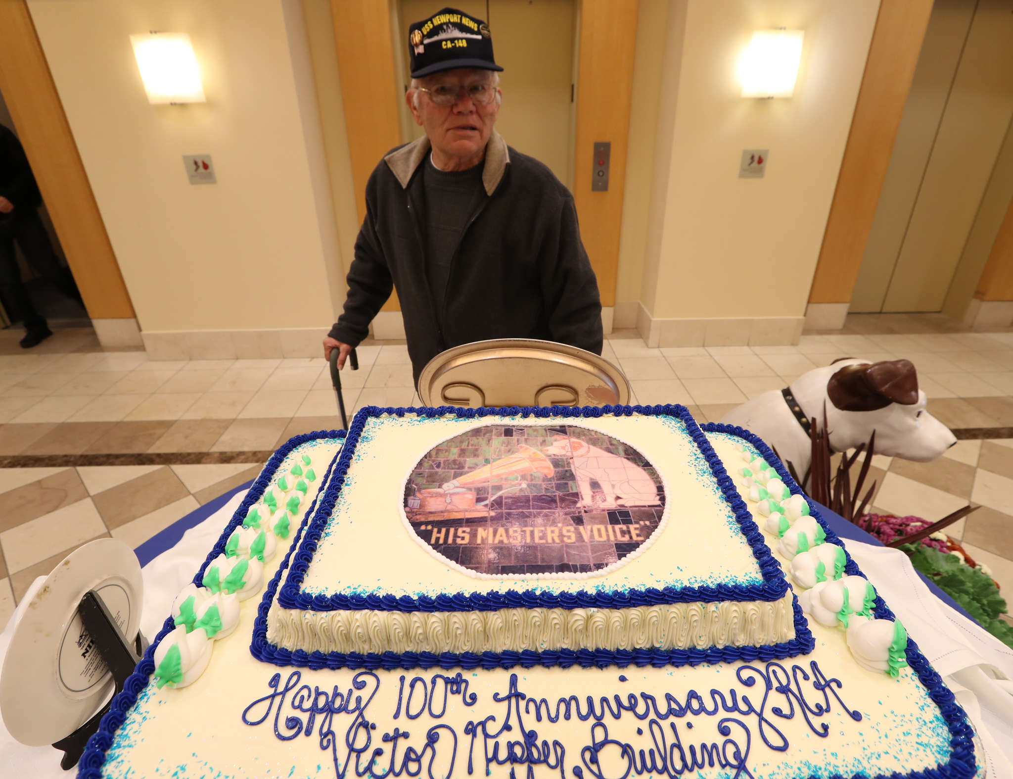 Bob Borchers checks out the cake at the gathering of former RCA employees. RCA´s Building 17 in Camden, affectionately known as the Nipper building and now home to the Victor Lofts apartments, is 100 years old this year.