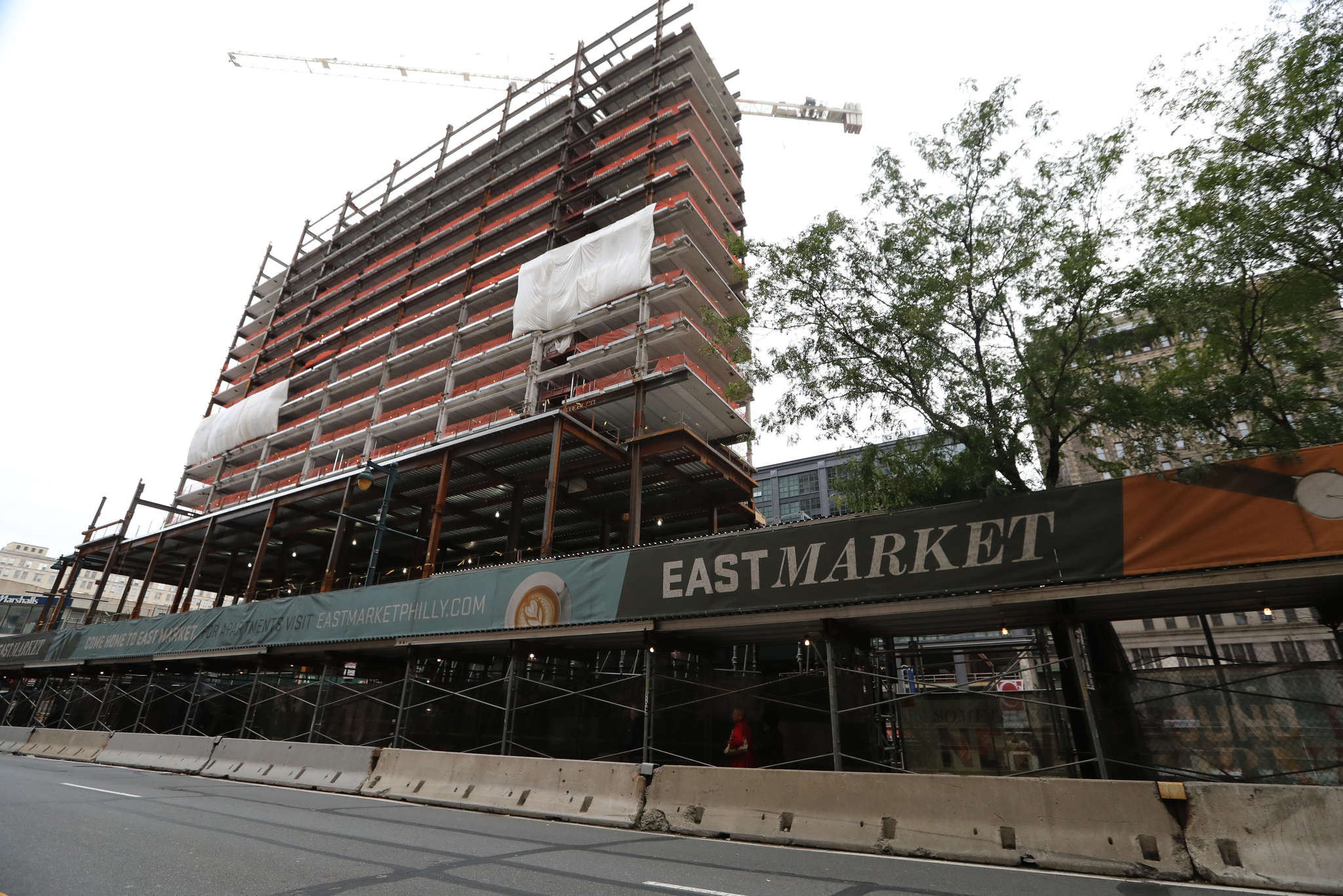 Viewed purely as a development incentive, there is no doubt the advertising district has been a roaring success. Here, the construction of the massive, mixed-use East Market project at 11th Street.<br />