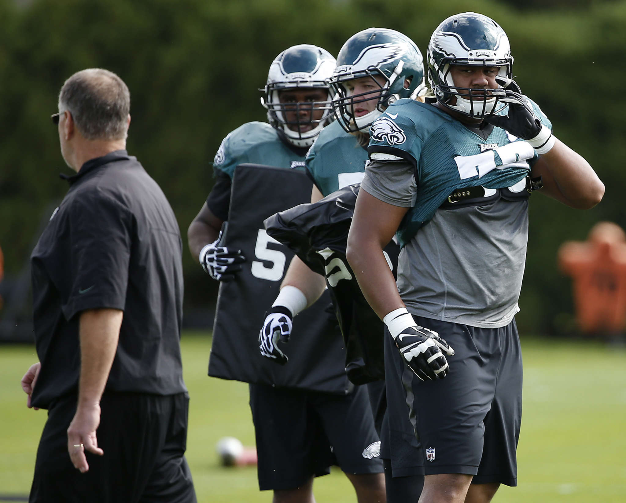 Halapoulivaati Vaitai looks back at coach Jeff Stoutland during Eagles practice at the NovaCare Complex on Wednesday. DAVID MAIALETTI / Staff Photographer
