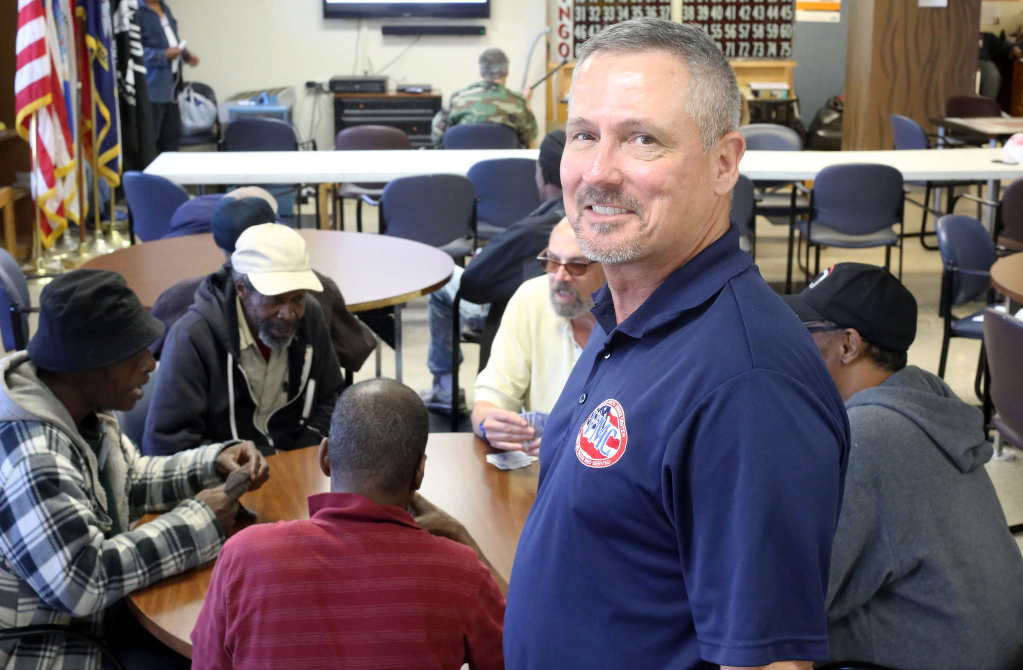 Tim Williams oversees veterans playing cards at the Veterans Multi-Service Center on North Fourth Street. He can relate: For him, the transition to civilian life was particularly rough.