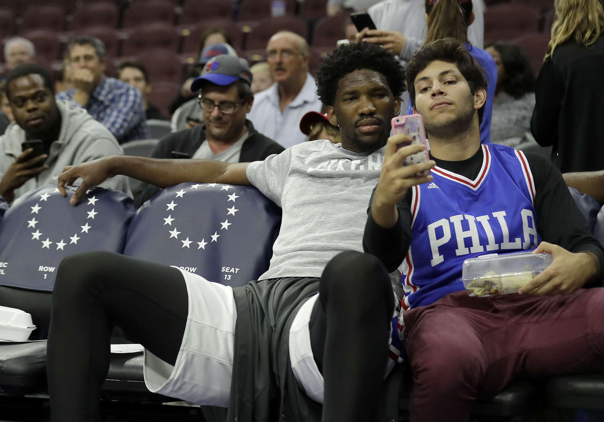 Sixers´ Joel Embiid gets photo taken with a fan before preseason loss to visiting Pistons on Saturday. YONG KIM / Staff Photographer