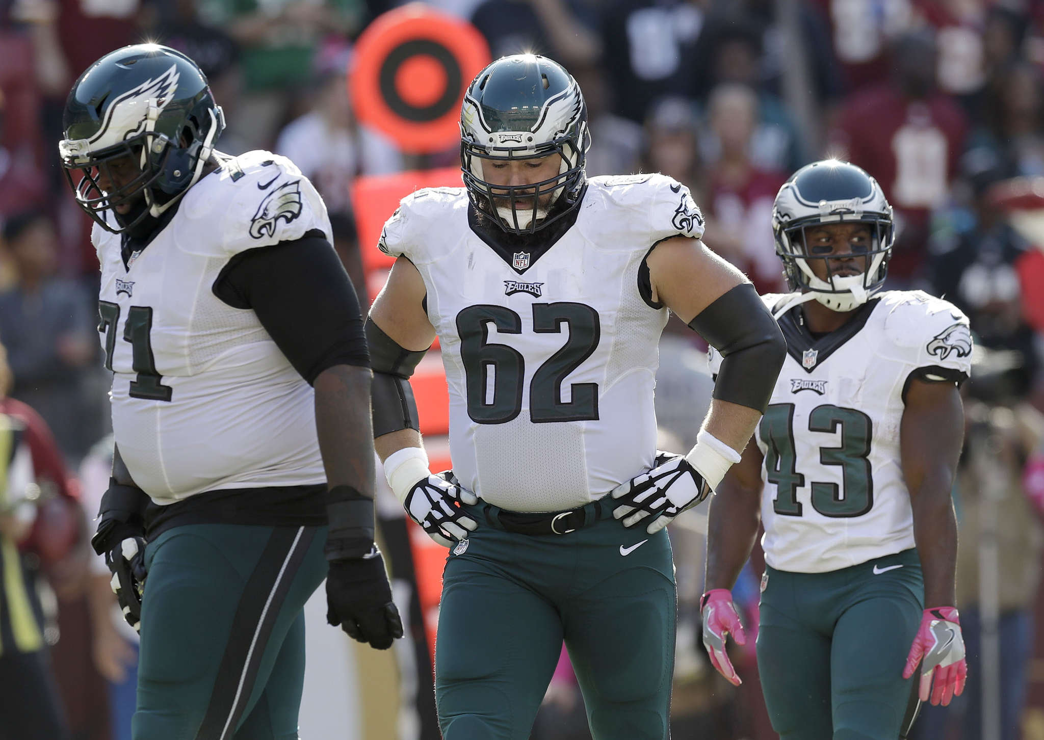 Jason Kelce (center), with Jason Peters (left) and Darren Sproles, after Kelce was called for a third-quarter penalty.