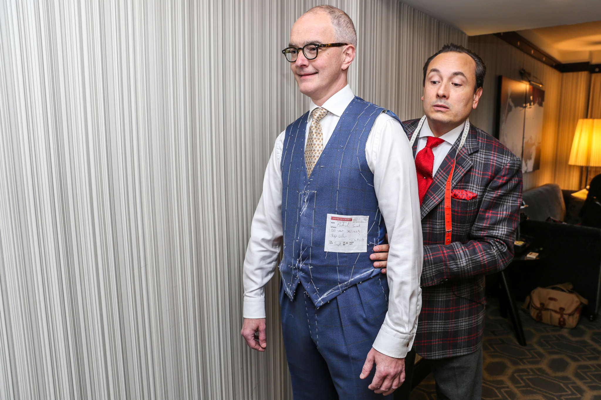 Master tailor Steven Hitchcock (right) conducts a suit fitting with photographer Patrick Snook.