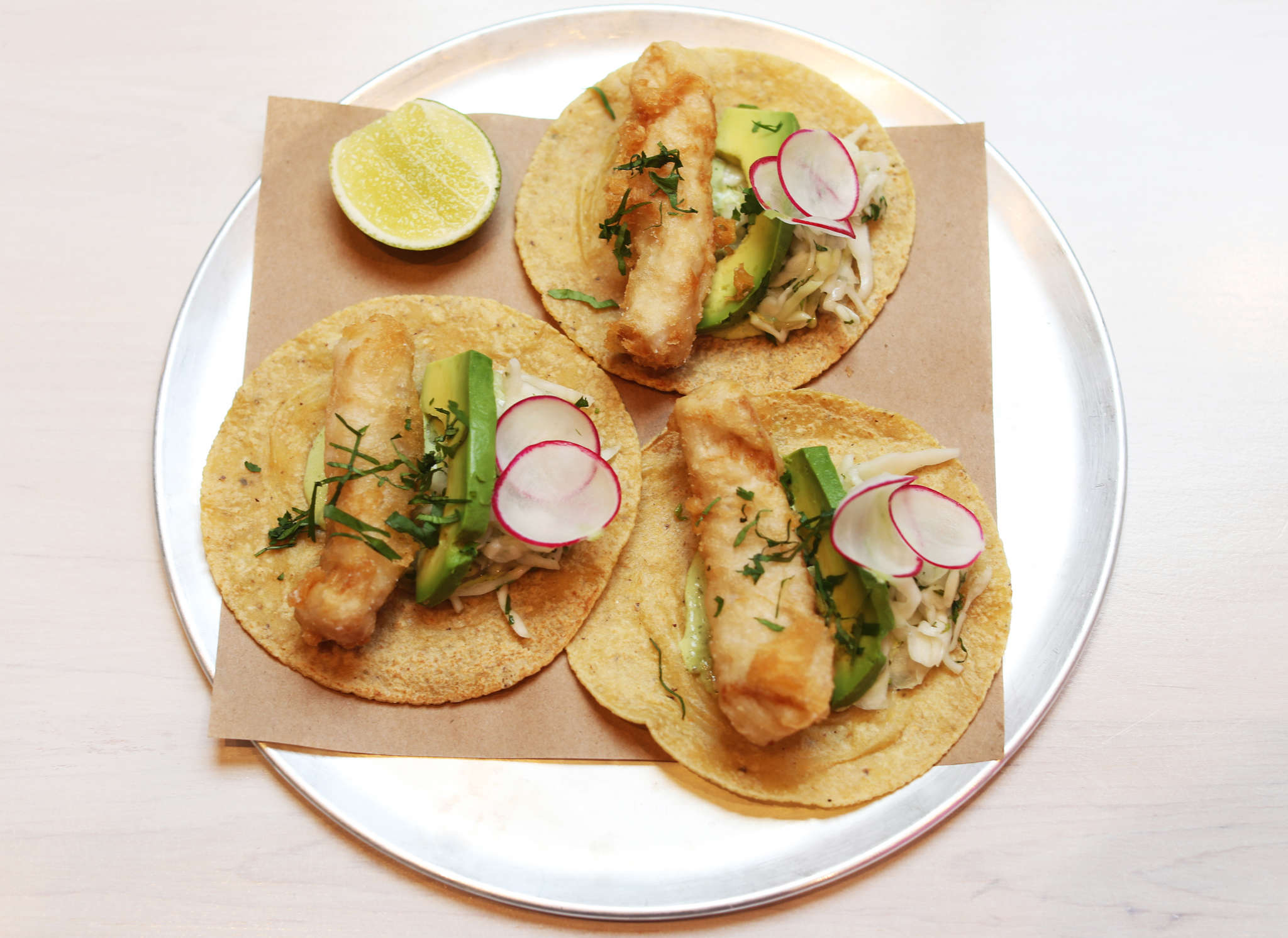 The mahi mahi tacos at Mission Taqueria have thick-cut bars of fish crisped inside a delicate rice flour batter.