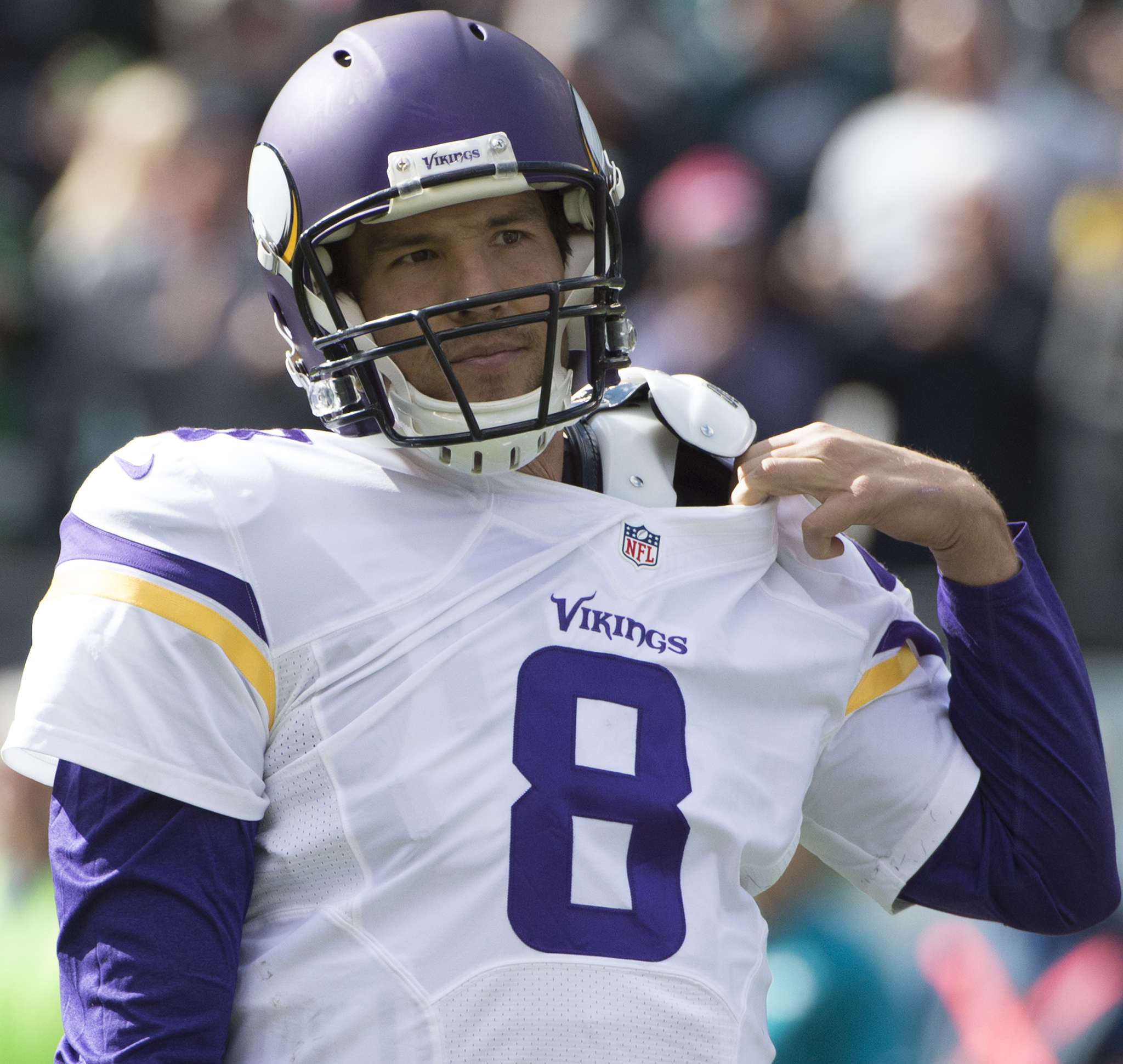 Sam Bradford adjusts his jersey after taking a hit. CLEM MURRAY/Staff Photographer