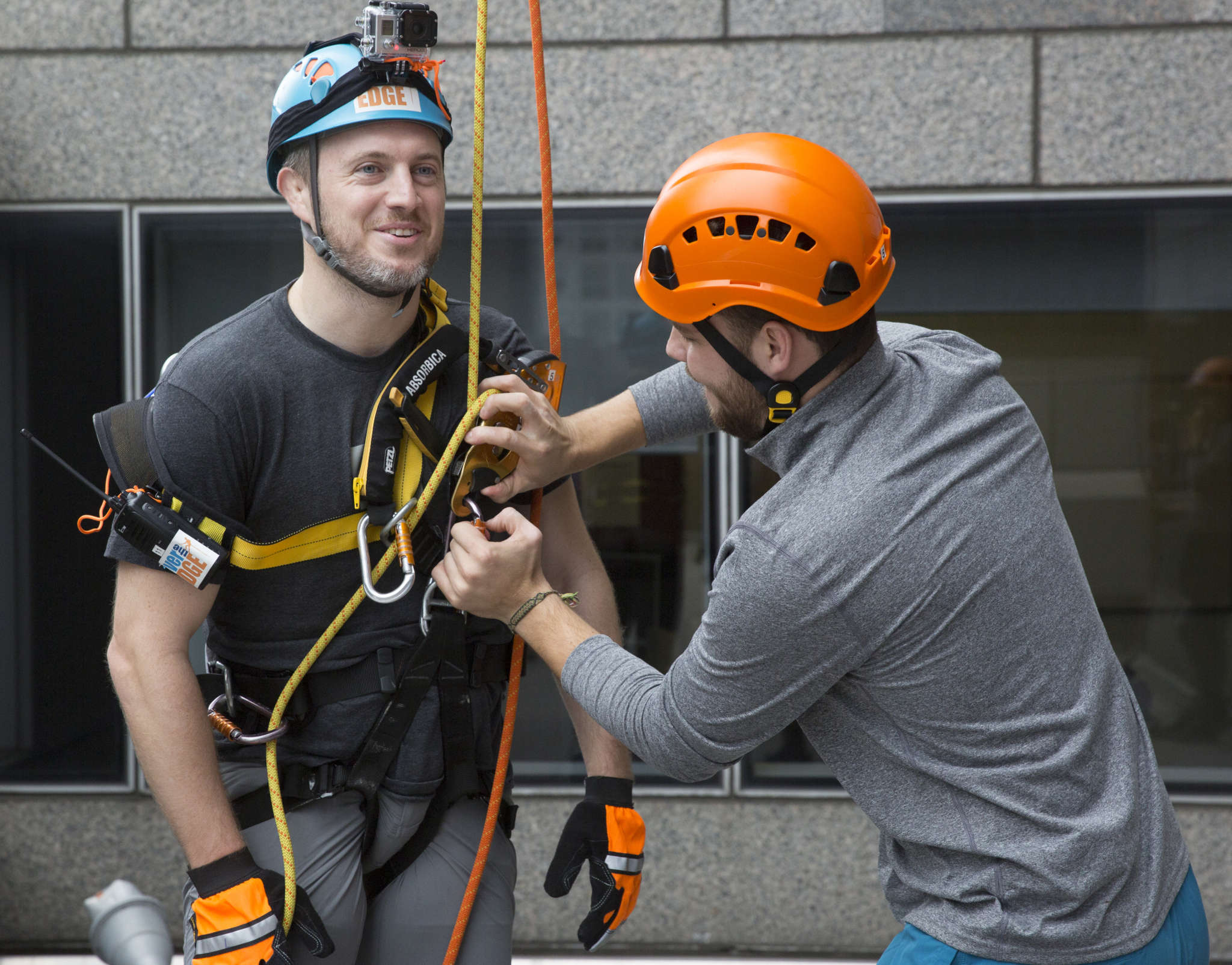 Mike Gadsby , cofounder of 03 World, a Fishtown company specializing in digital production, lands on the ground after rappelling down Two Commerce Square. JESSICA GRIFFIN / Staff Photographer