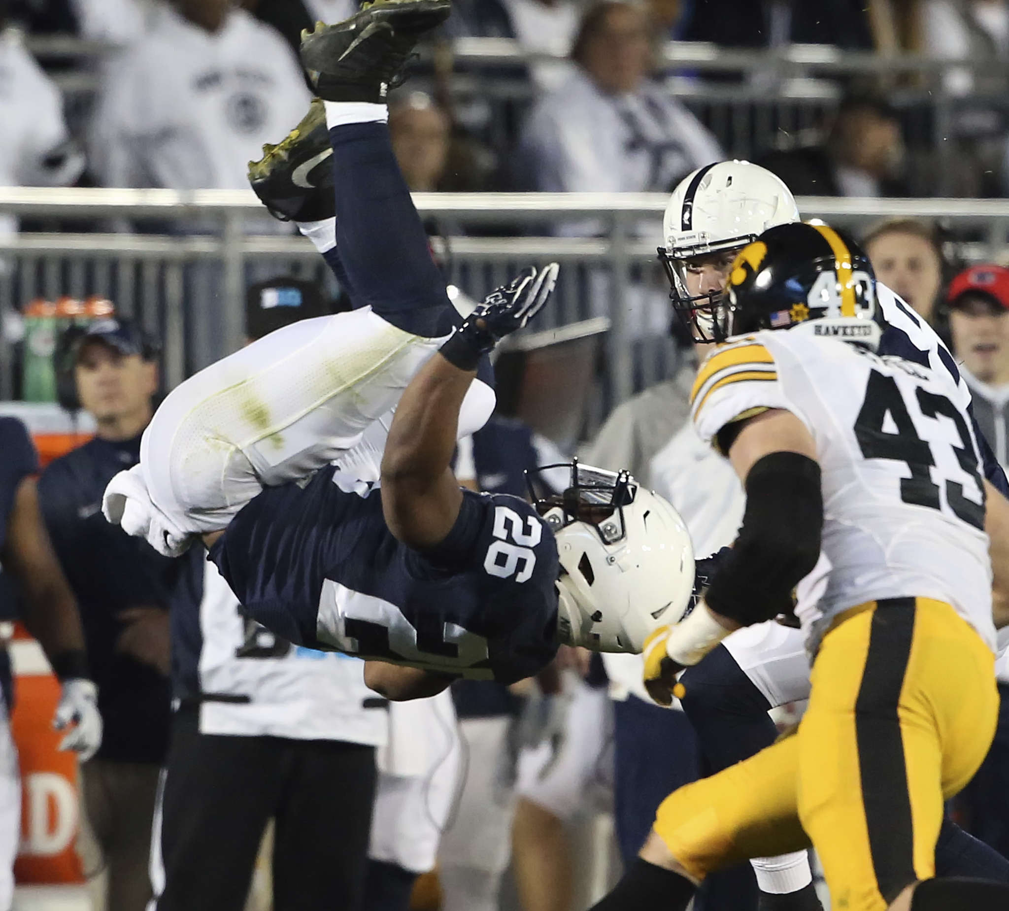 Penn State´s Saquon Barkley flips after being hit in Saturday night´s win over Iowa. ASSOCIATED PRESS