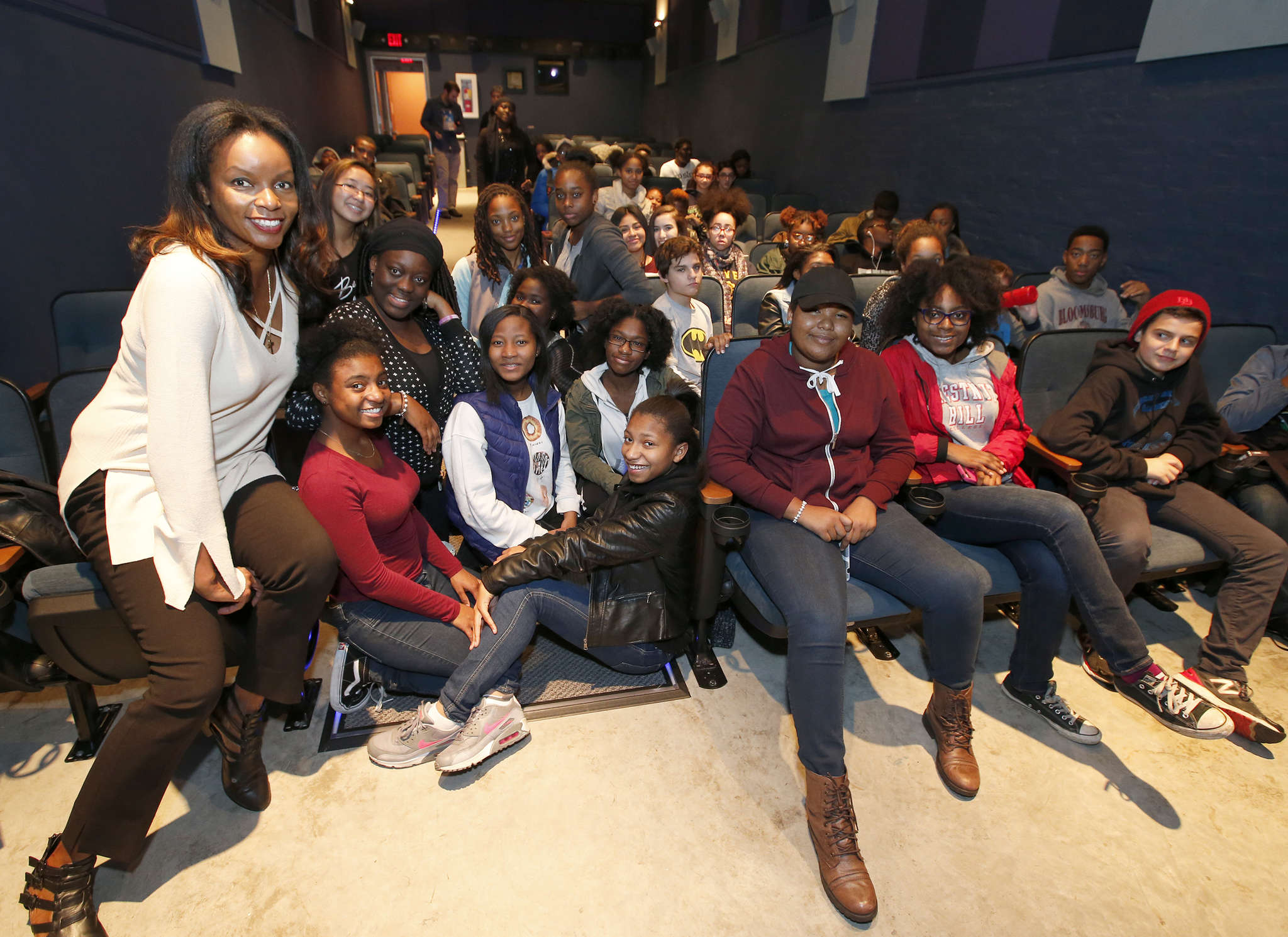 """People Paper columnist Jenice Armstrong with students from Science Leadership Academy before a screening of the new film """"Loving."""" CHARLES FOX / Staff Photographer"""