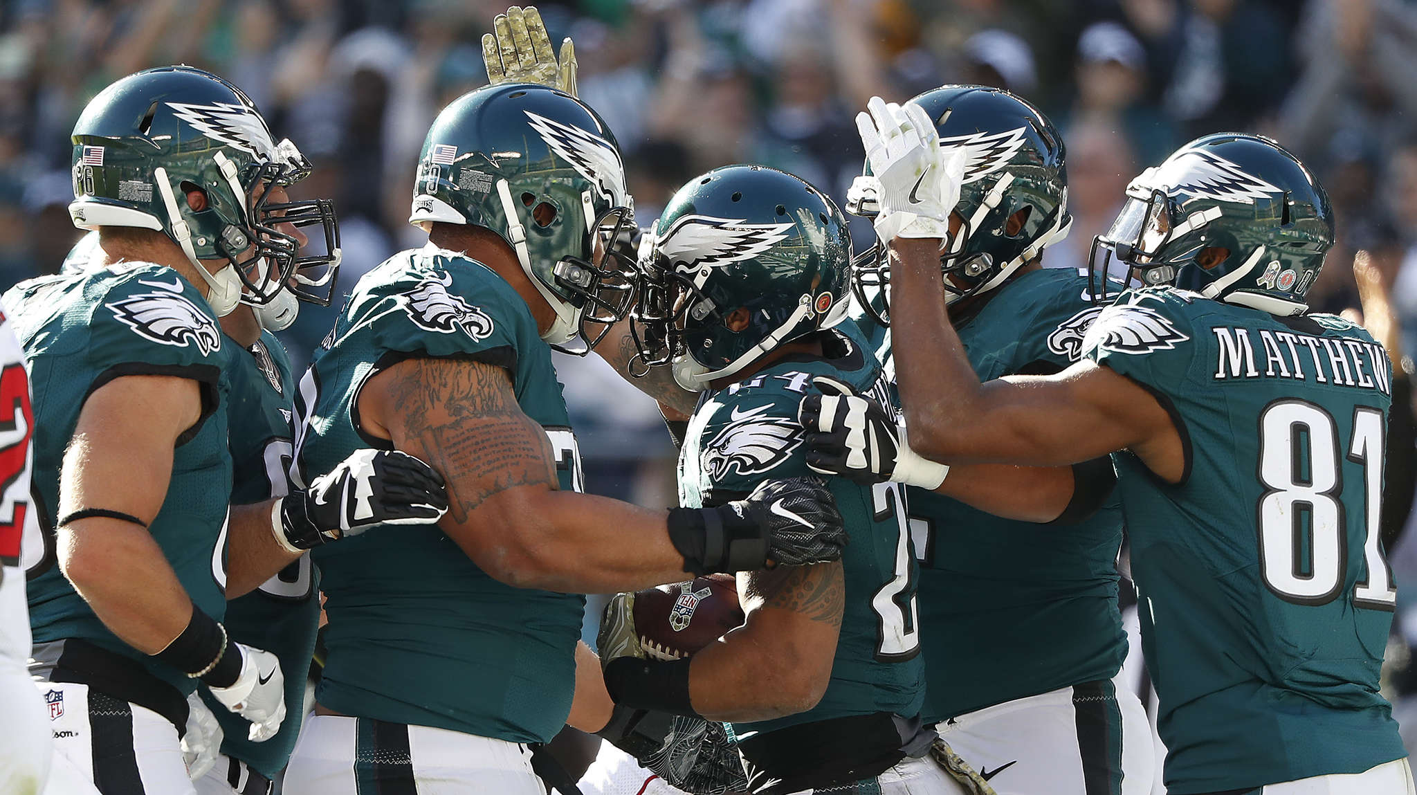 Ryan Mathews is popular with his teammates after scoring on opening drive. DAVID MAIALETTI / Staff Photographer