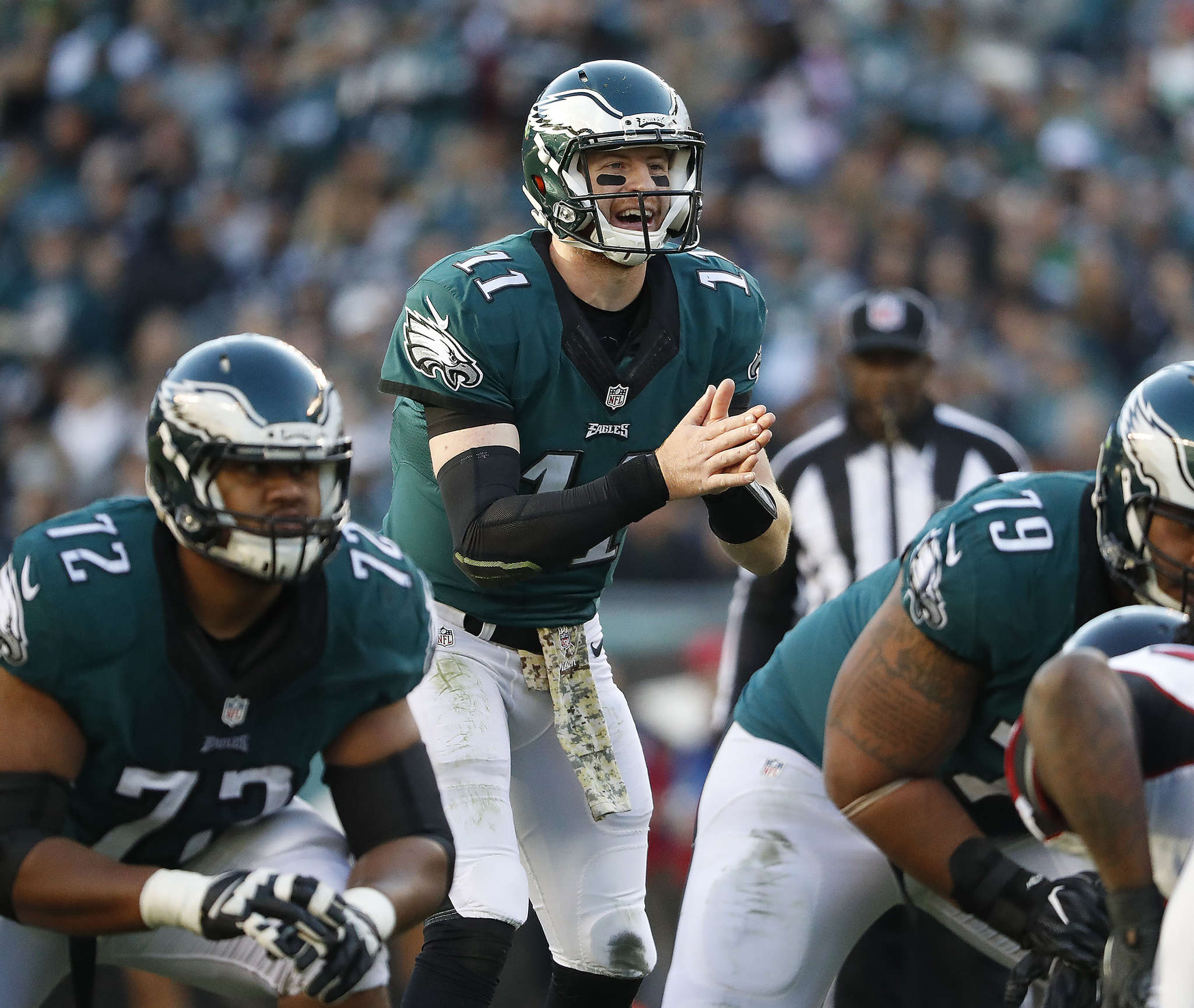 Carson Wentz, who played an efficient game, waits for snap in the third quarter. DAVID MAIALETTI / Staff Photographer