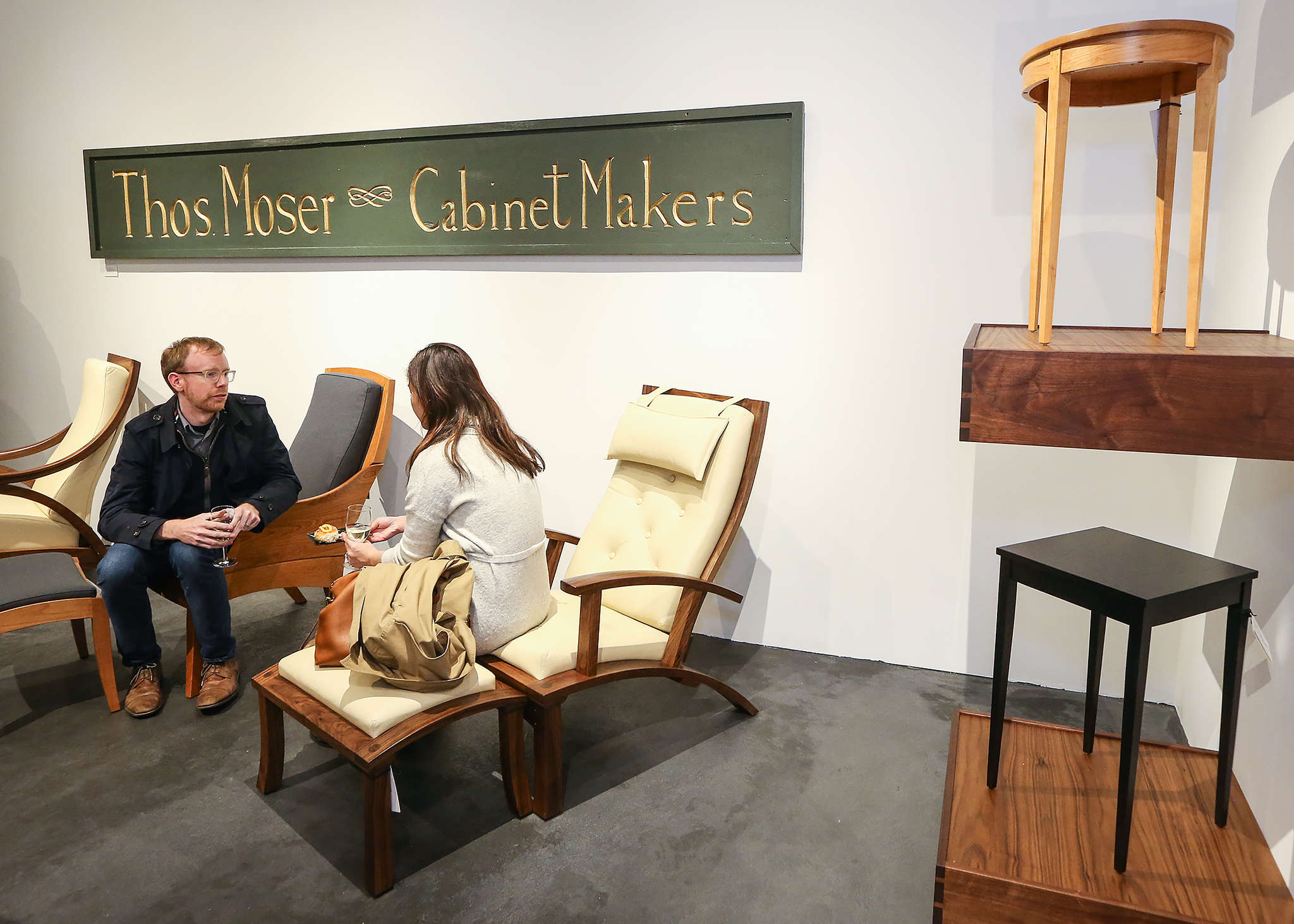 Eric Heidel and Sary Em relax during the opening of furniture-maker Thos. Moser´s new Walnut Street location.