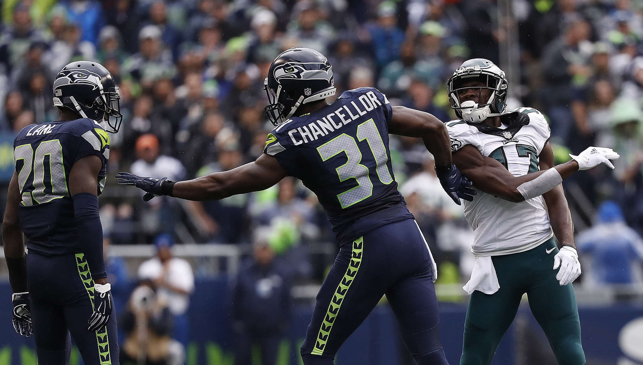Eagles wide receiver Nelson Agholor takes a swipe at Seahawks safety Kam Chancellor as cornerback Jeremy Lane looks on. DAVID MAIALETTI / Staff Photographer