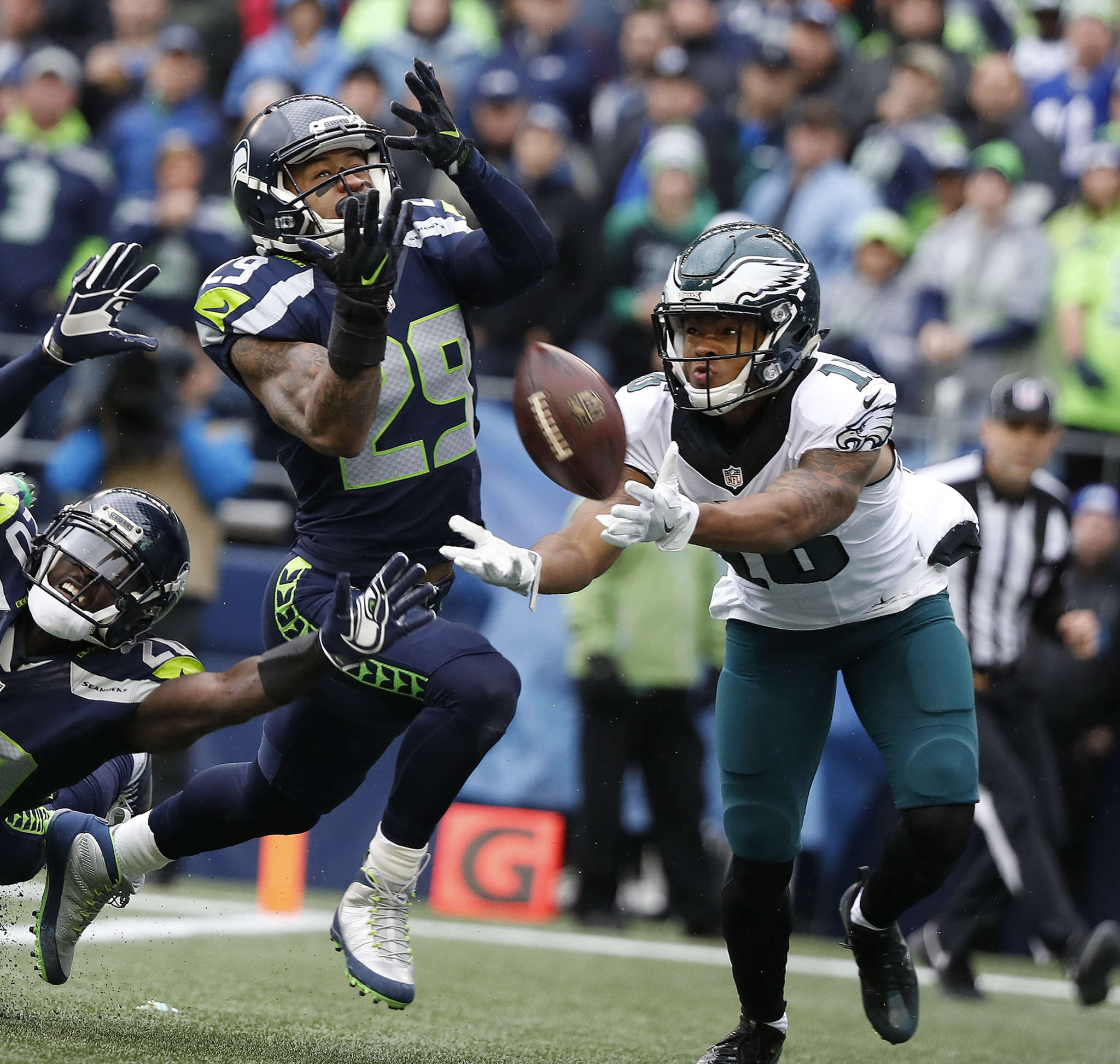 Eagles´ Bryce Treggs fails to catch pass as Seahawks´ Jeremy Lane (left) and Earl Thomas defend. DAVID MAIALETTI /Staff Photographer