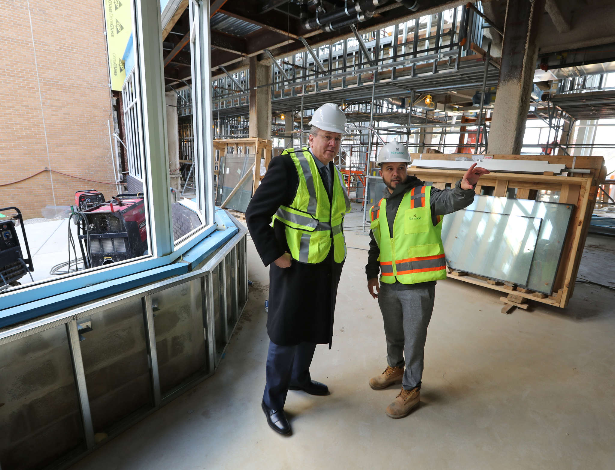 Touring the construction site are Joseph W. Devine (left), Kennedy Health CEO and president, and project manager Ryan Spotts.