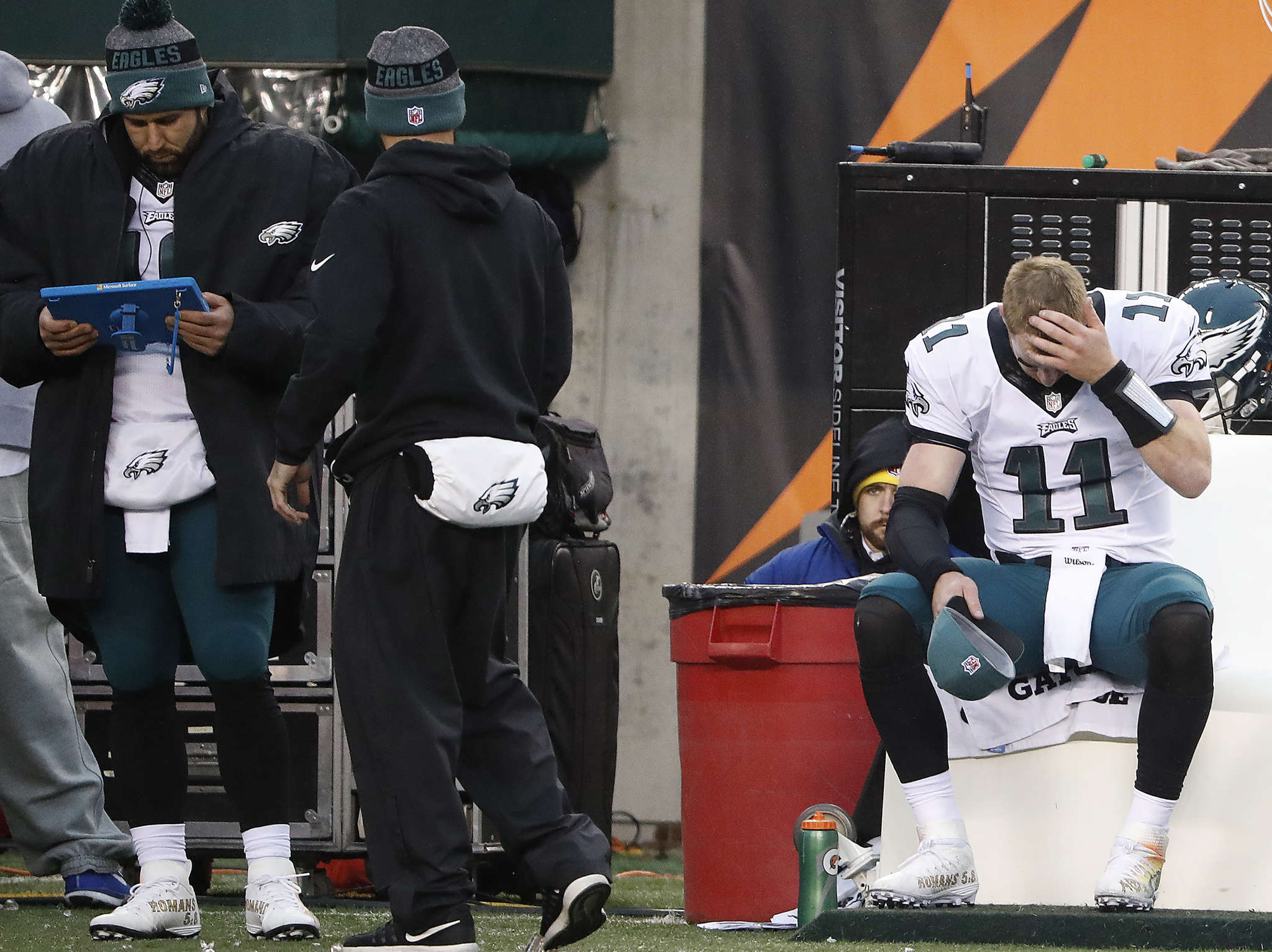 Carson Wentz sits on the bench in the fourth quarter after throwing his third interception of the game.