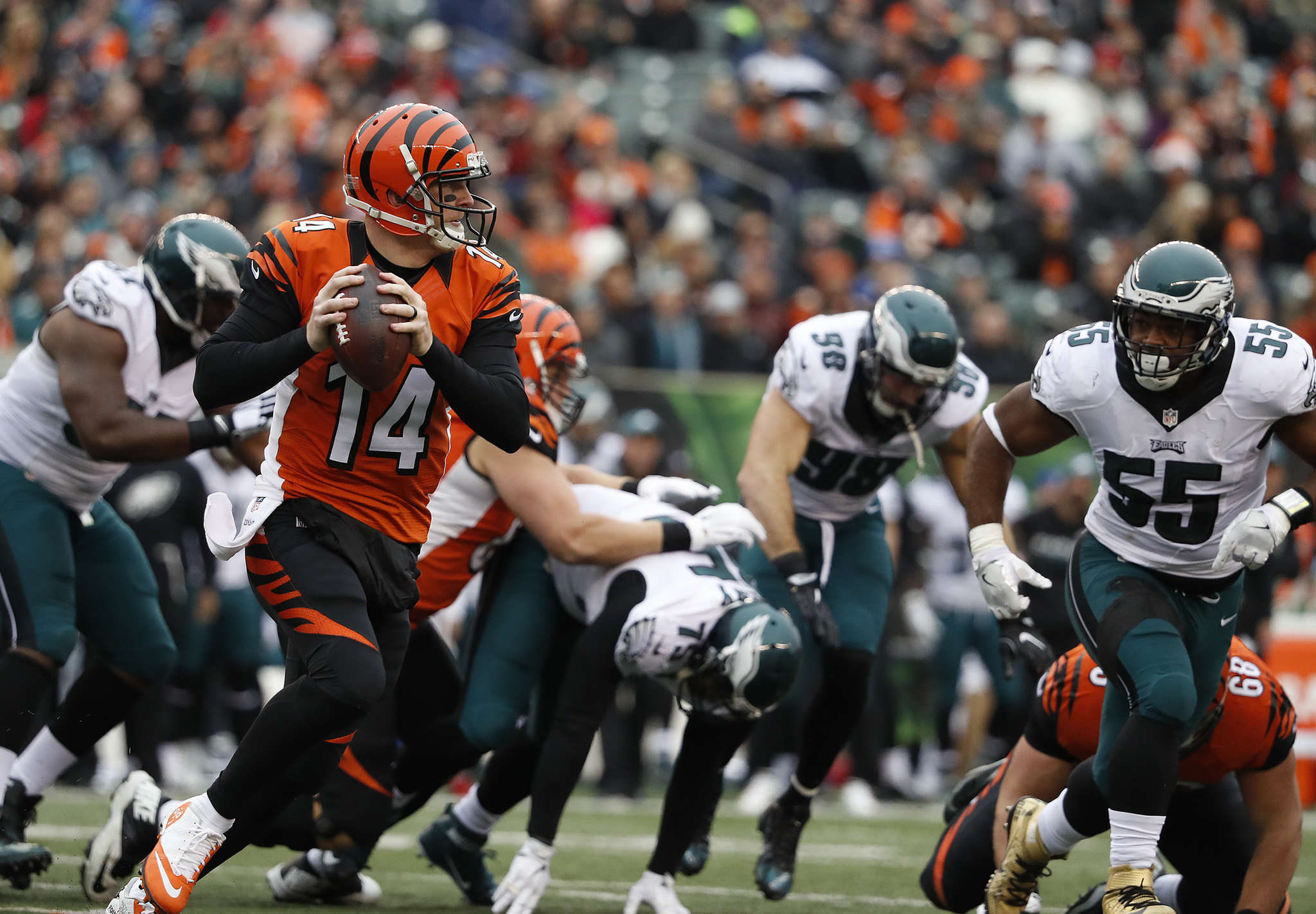 Andy Dalton evades the Eagles´ pass rush and looks downfield late in the second quarter. DAVID MAIALETTI / Staff Photographer