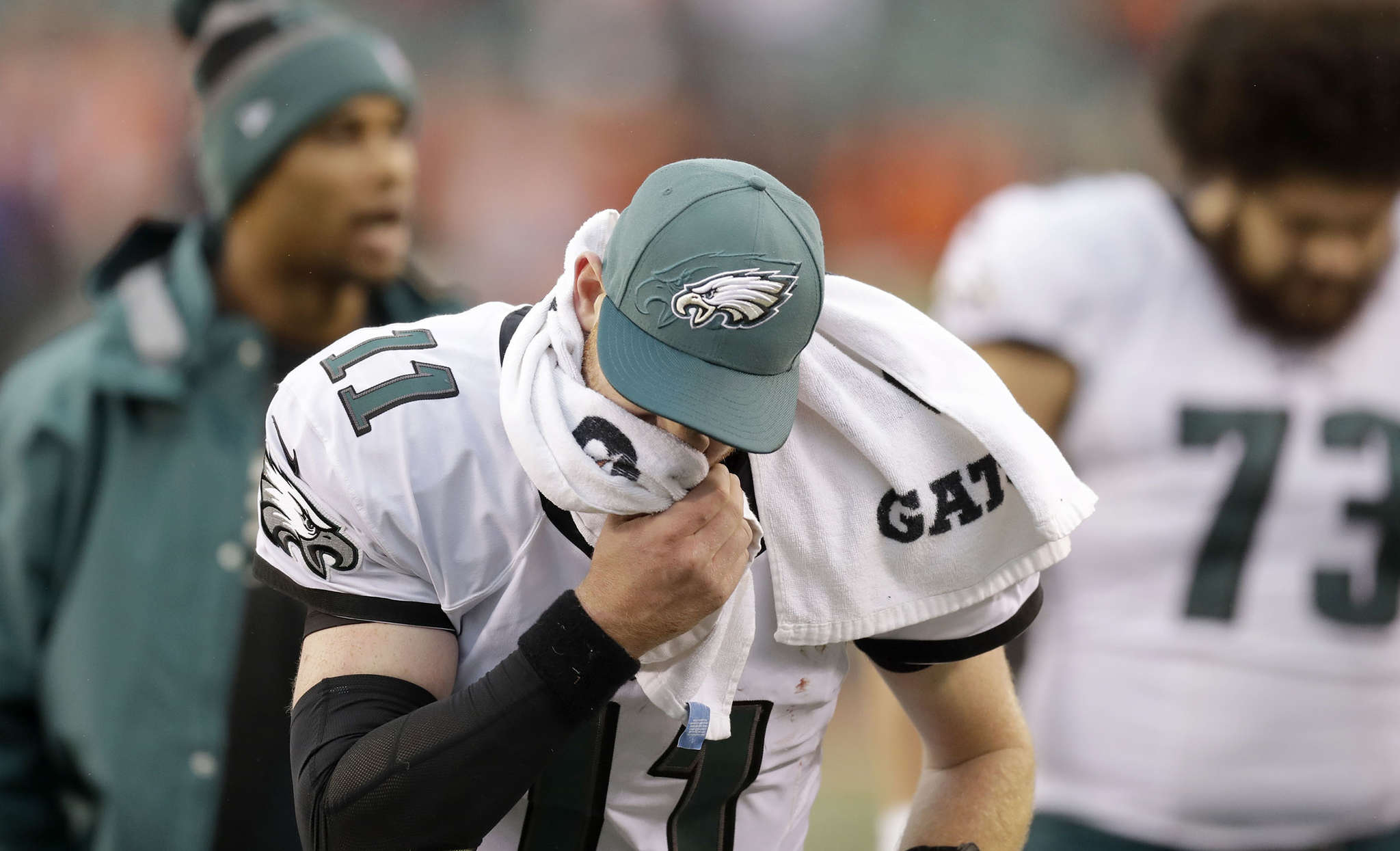 Eagles quarterback Carson Wentz wipes his face as he leaves the field after the loss to the Bengals. YONG KIM / Staff Photographer