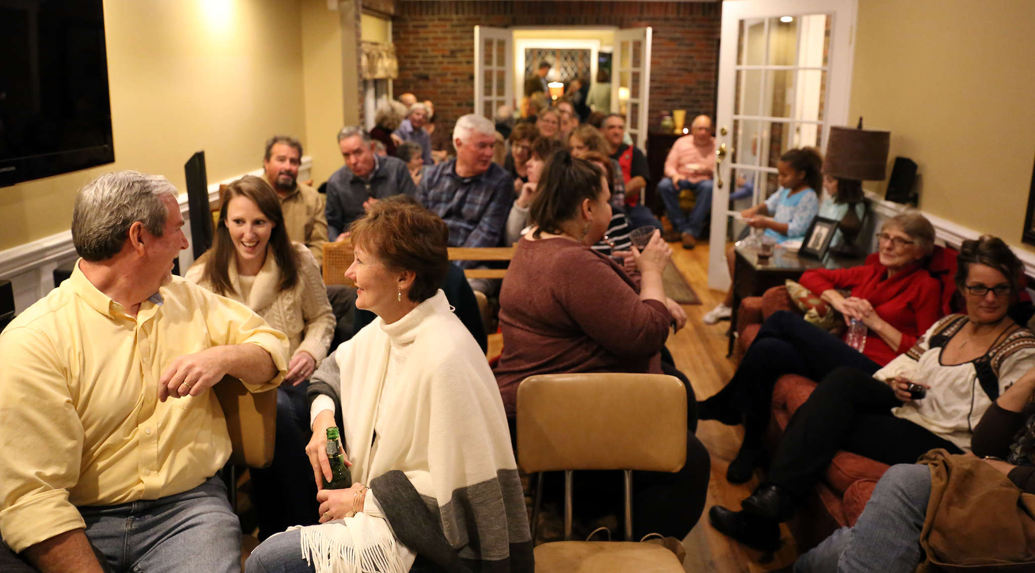 An audience awaits Klein and June´s performance. House concerts like the McHughs´ allow people to listen to a band in an inexpensive, convenient, and convivial space where music takes priority over texting or taking selfies.