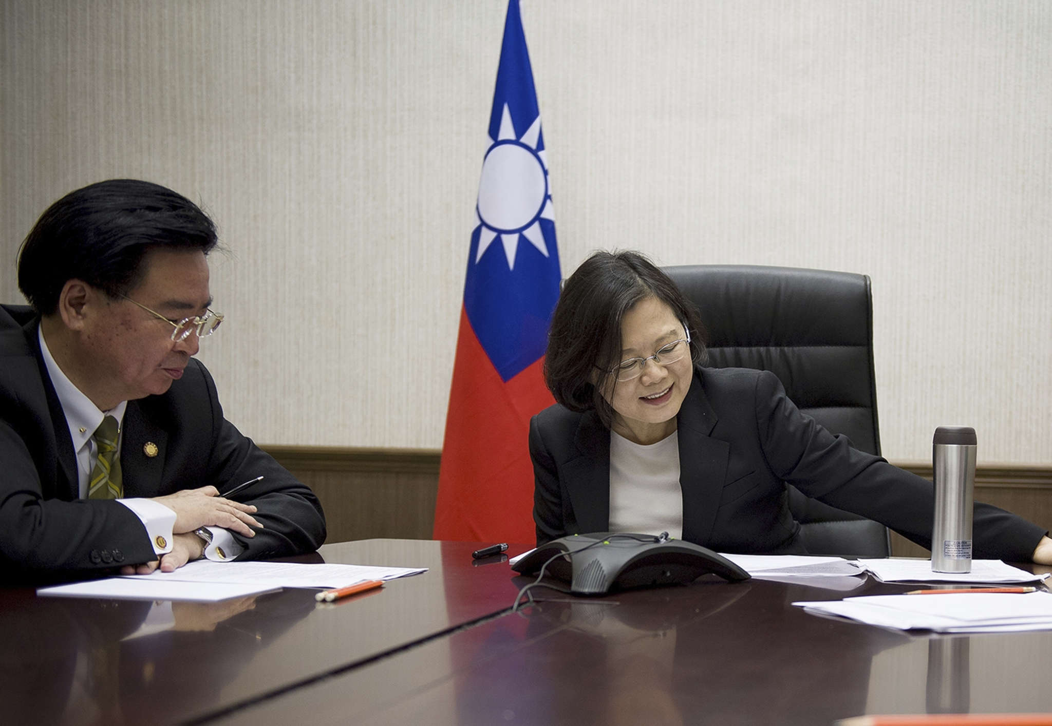 Taiwan President Tsai Ing-wen speaking with President-elect Donald Trump on Dec. 2 through a speaker phone in Taipei. With her is Joseph Wu, National Security Council secretary-general.