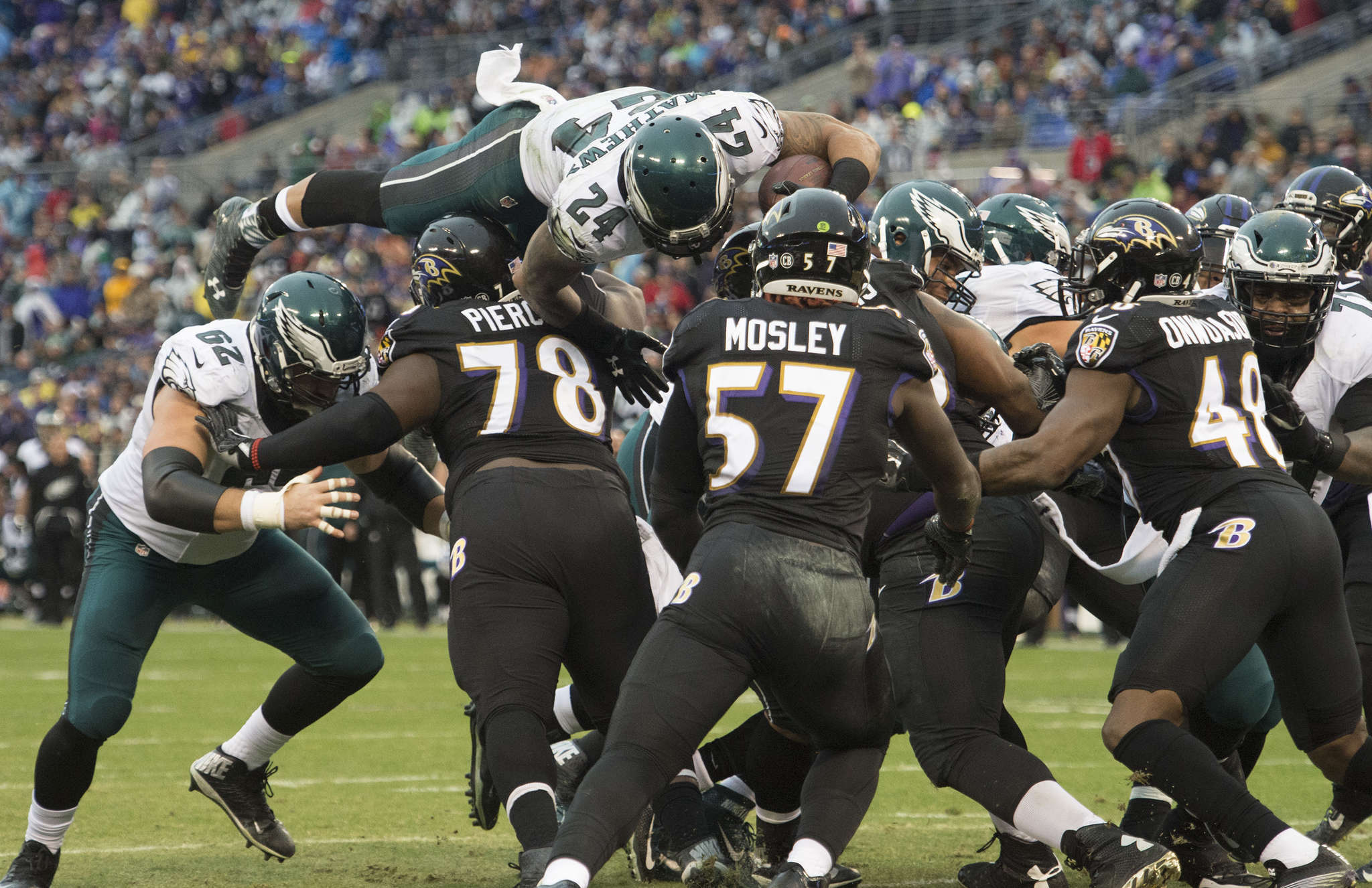 Eagles´ Ryan Mathews soars over line of scrimmage on two-point conversion run in second quarter. CLEM MURRAY / Staff Photographer