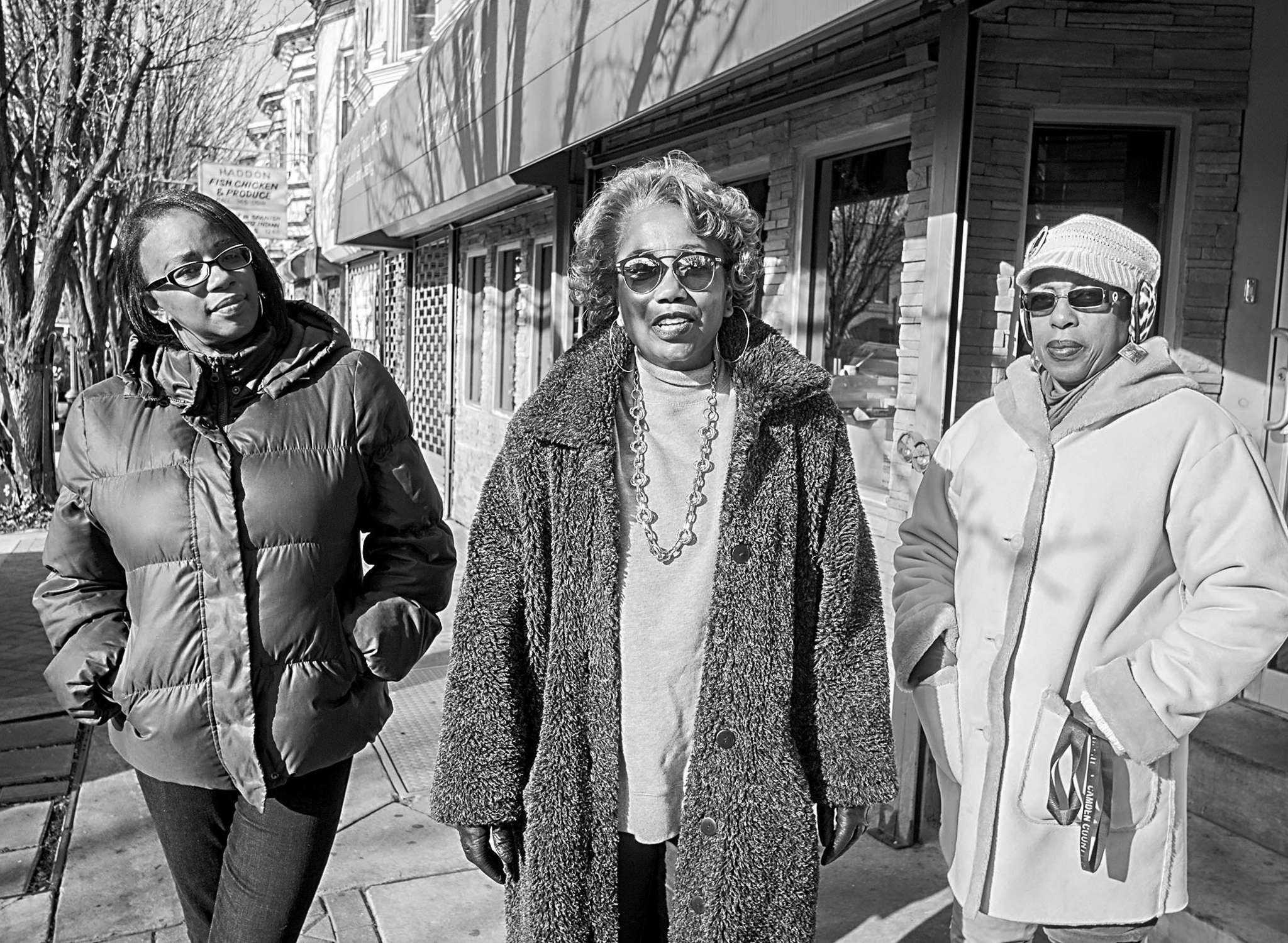 Parkside Business and Community in Partnership executive director Bridget Phifer (center) with community outreach specialists Miosha Lawrence (left) and Sheila Greene on Haddon Avenue, where the group is working to revitalize vacant properties.