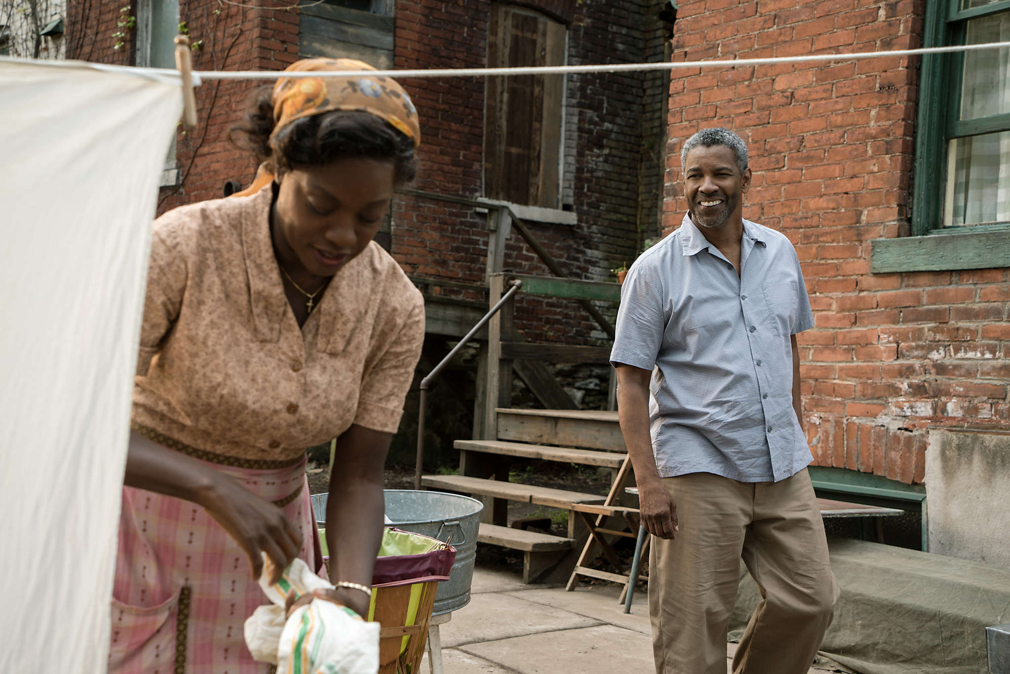 "Denzel Washington is Troy Maxson and Viola Davis his wife, Rose, reprising their Broadway roles in the film ""Fences,"" opening Christmas Day."