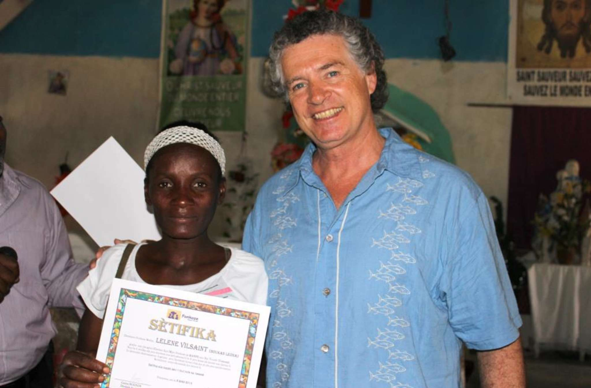 Matt Balitsaris, former chairman of Fonkoze USA, with Lilene Vilsaint, who graduated from the Fonkoze program in Bay Tourib, Haiti.