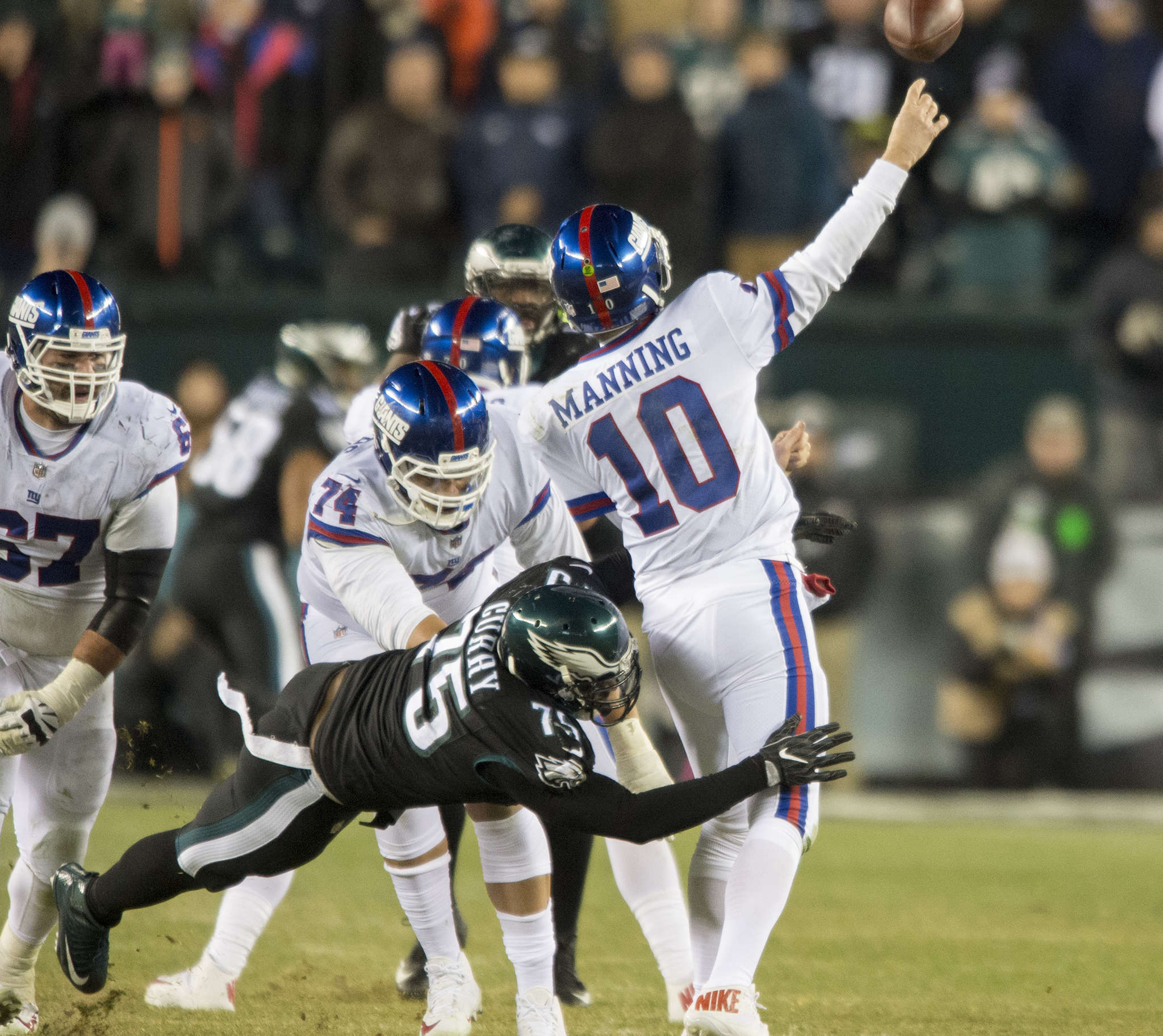 Vinny Curry pressures Eli Manning into throwing game-clinching interception.