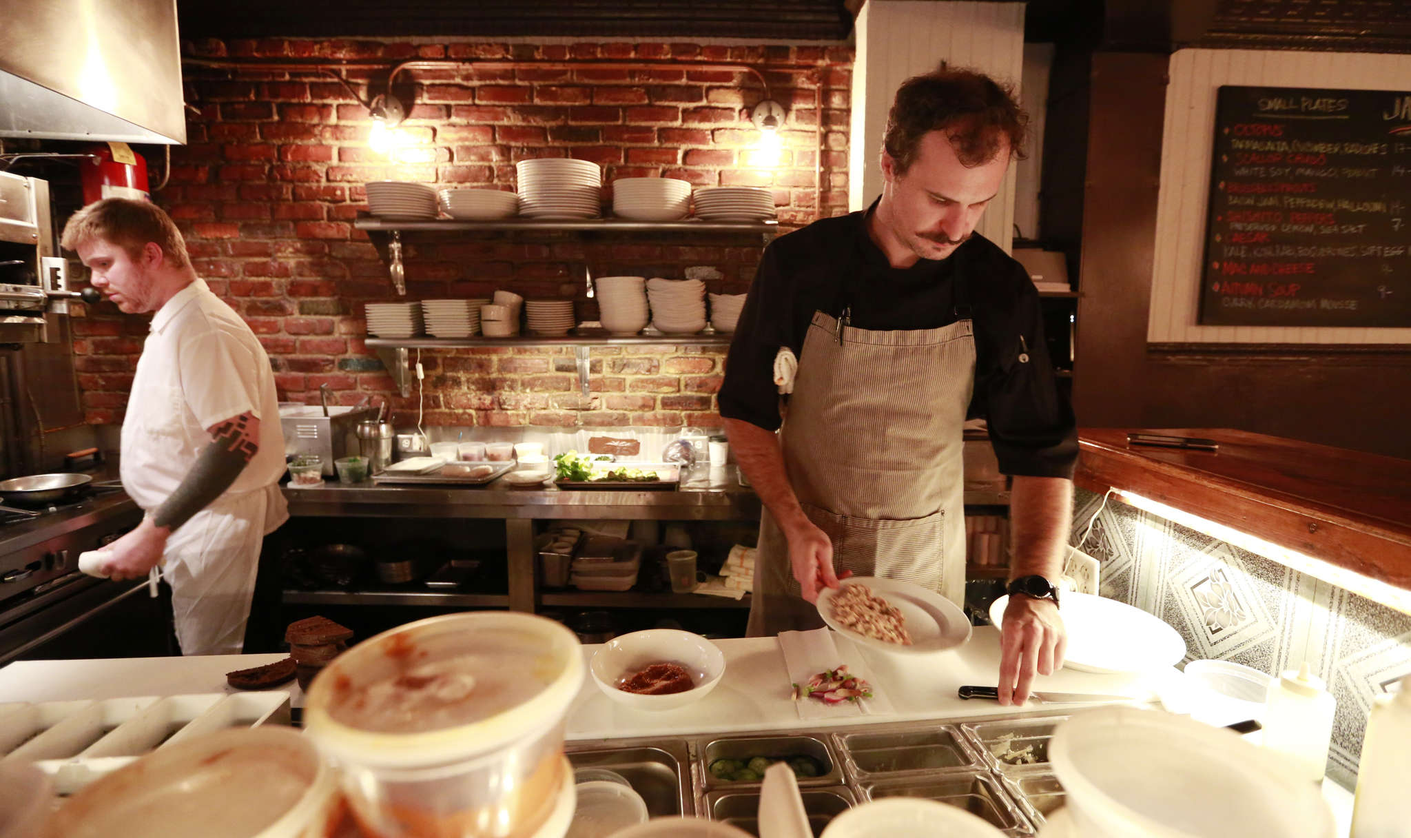 Chef Matthew Gansert (right) at work in Jaxon´s kitchen. His menu features fluid New American cooking.