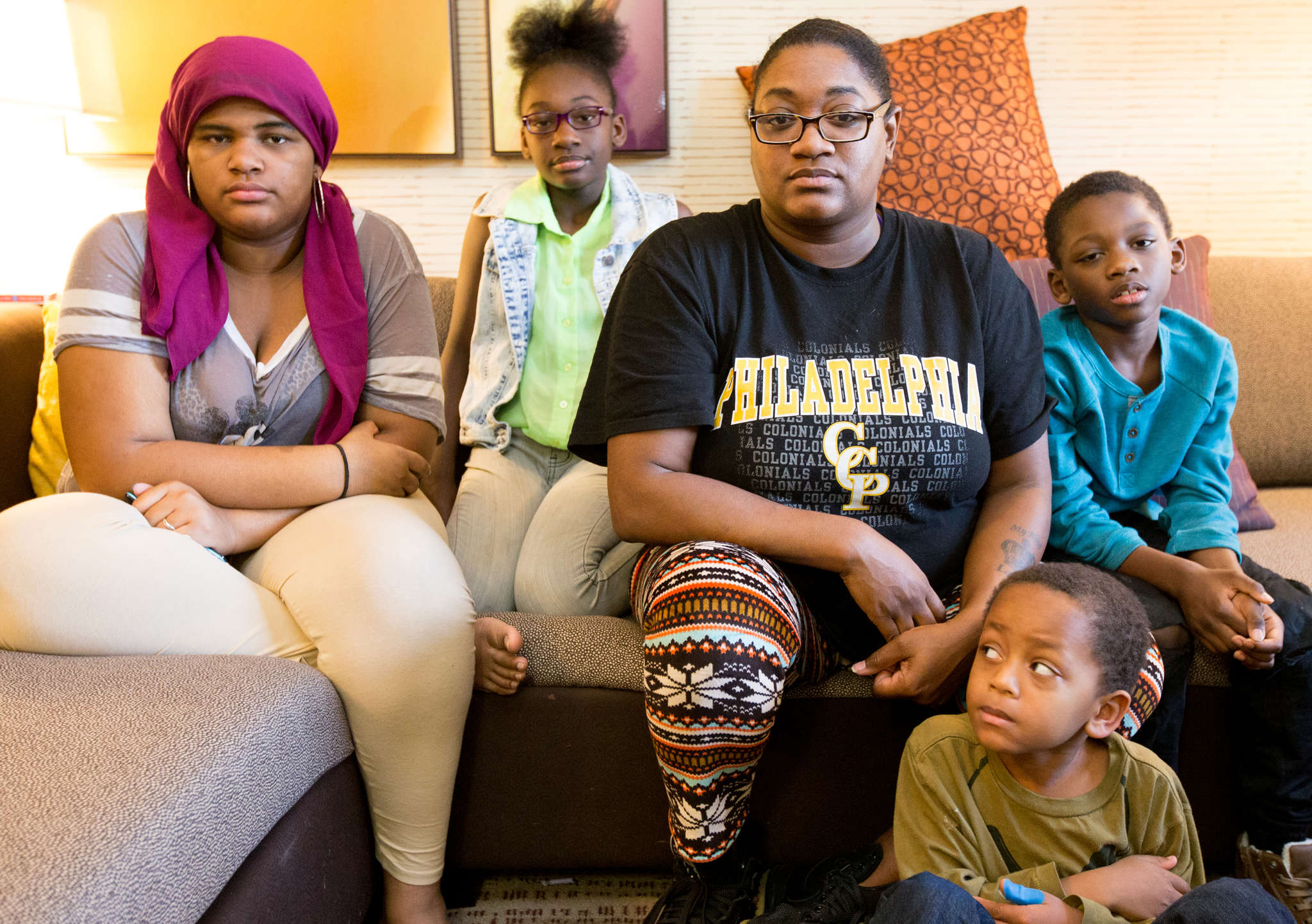 J´Naiha Lamboy (from left), Lyric Cogdell, Maloni Greene, Robert Cogdell, and Kamari Brant are staying at a Residence Inn after their home was damaged in a fire. JESSICA GRIFFIN / Staff Photographer