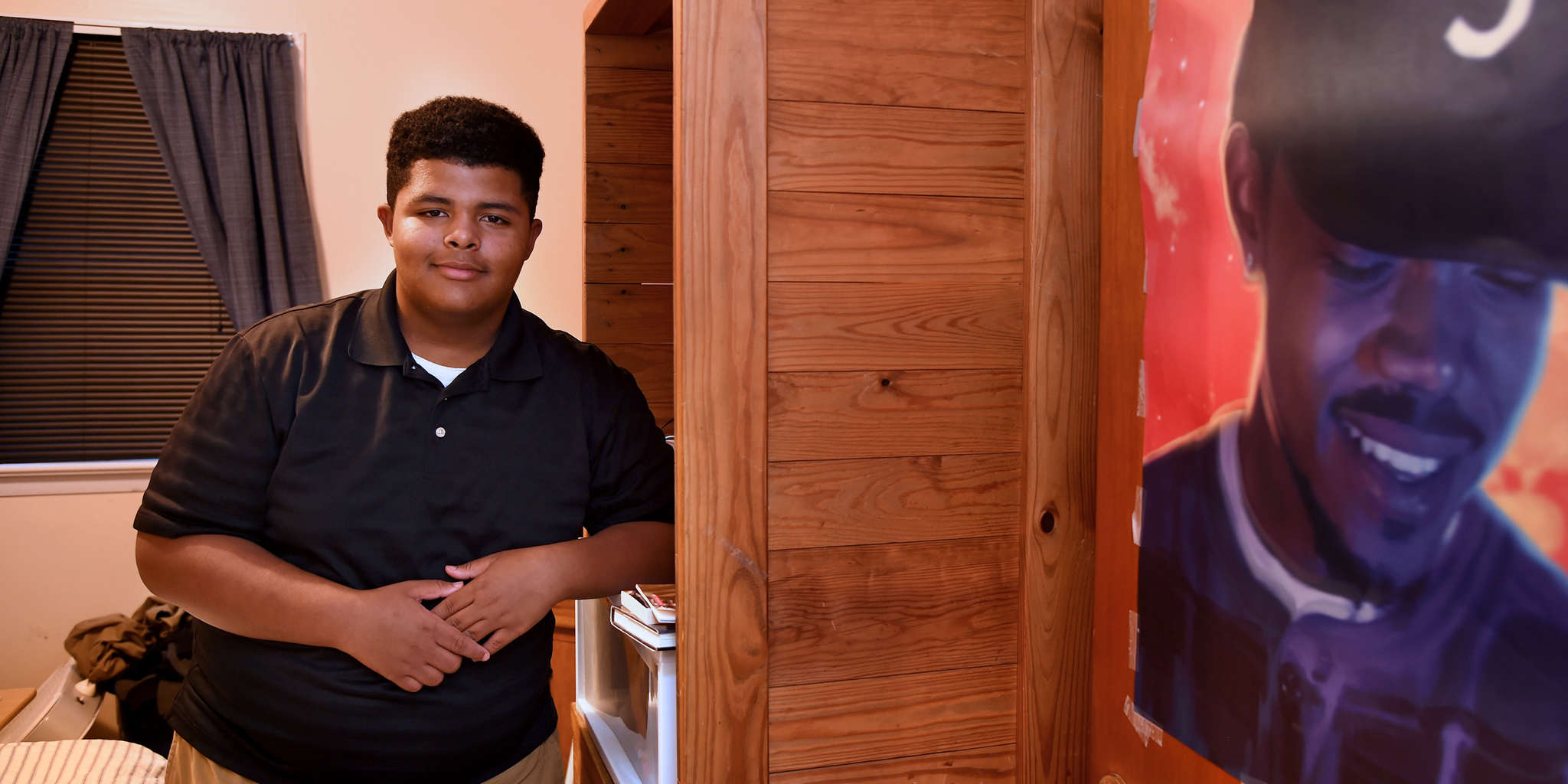Manny Martinez , 13, in his bedroom with a poster of his idol, Chance the Rapper, followed his conscience. TOM GRALISH / Staff Photographer