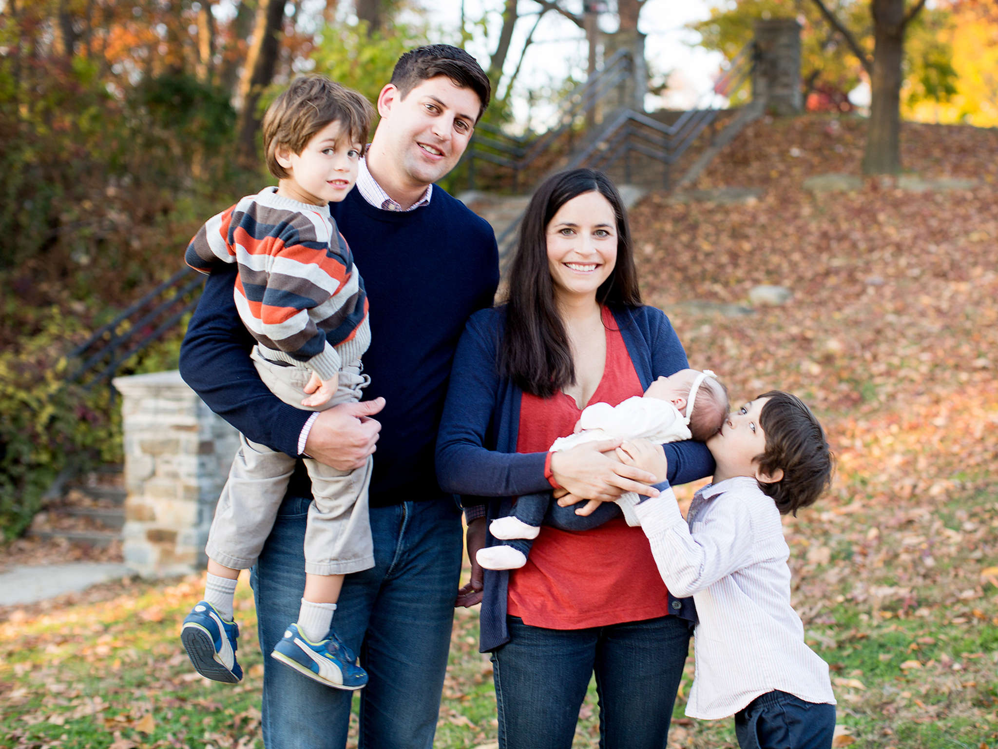 Dad Jason with Abram, mom Elyse with Margot, and big brother Holden.